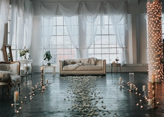 beige sofa in white sheer curtained room