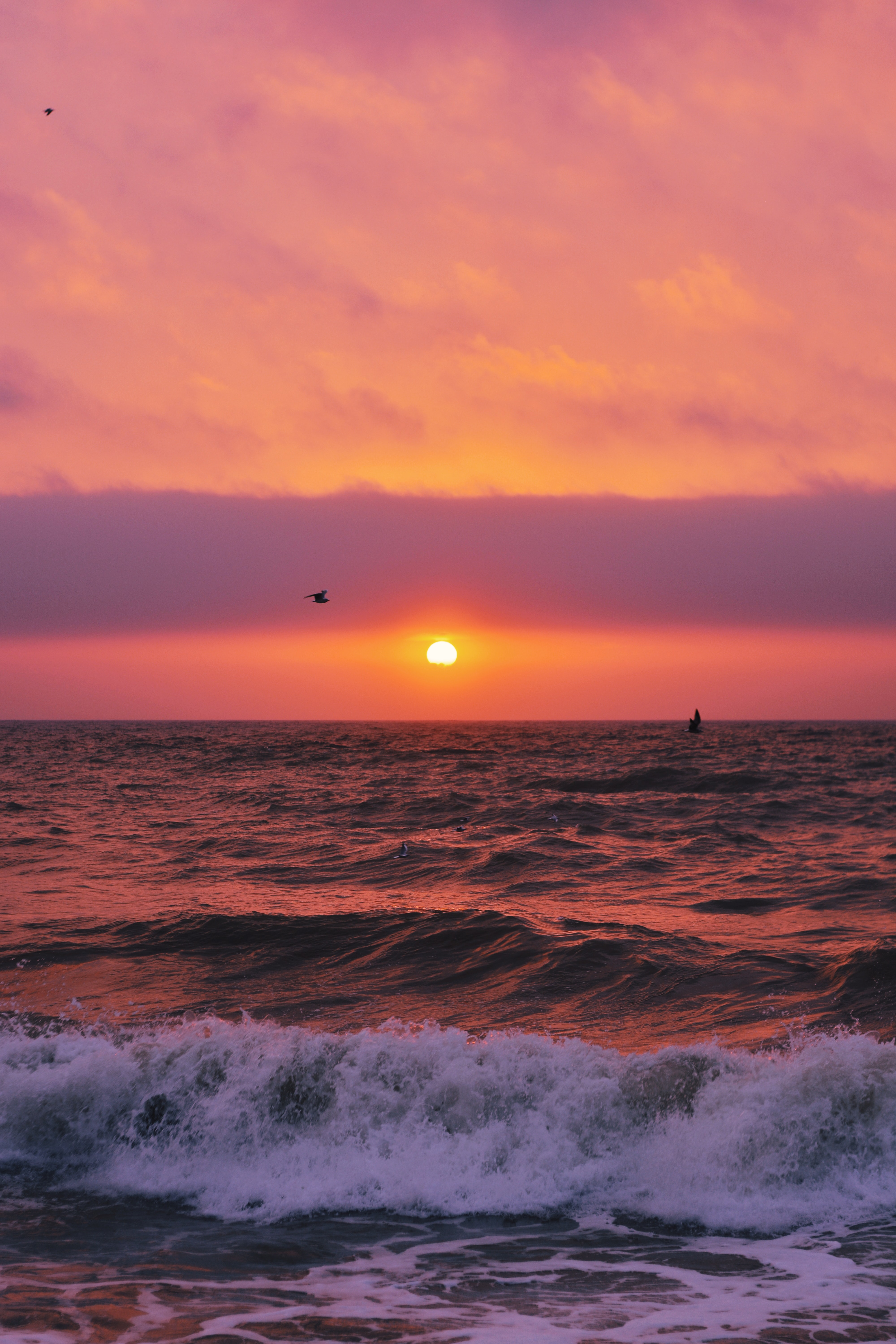 time lapse photography of ocean waves during sunset