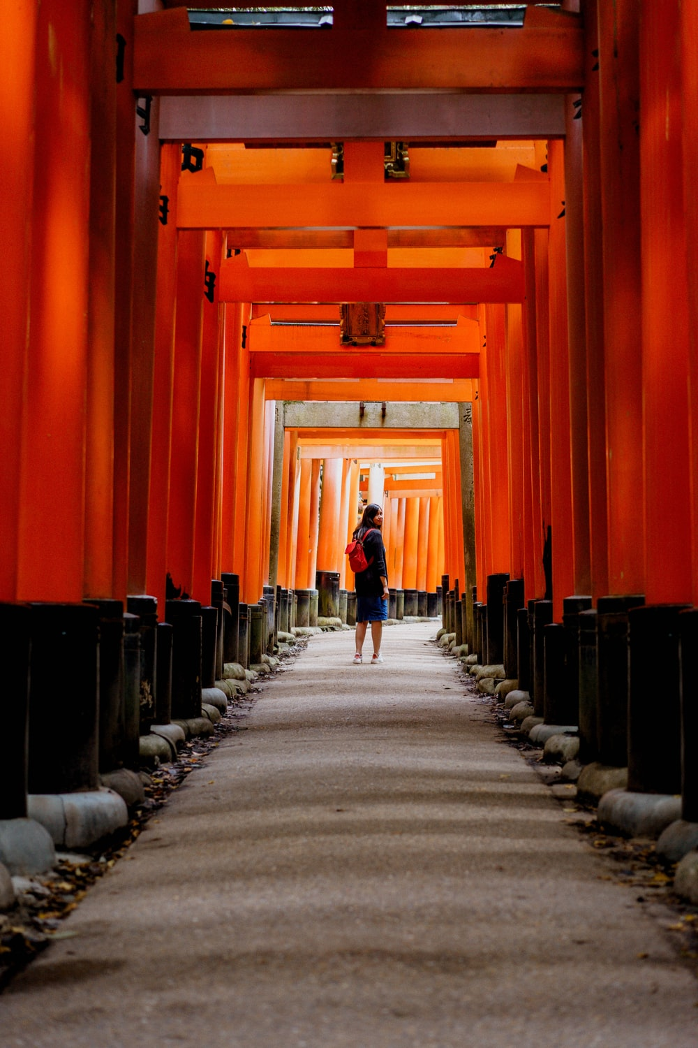woman under red and black shrine