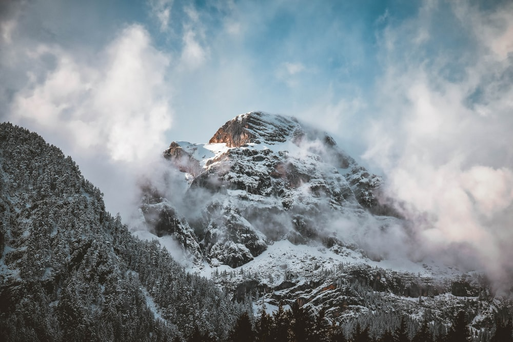 brown mountain covered of snow during daytime