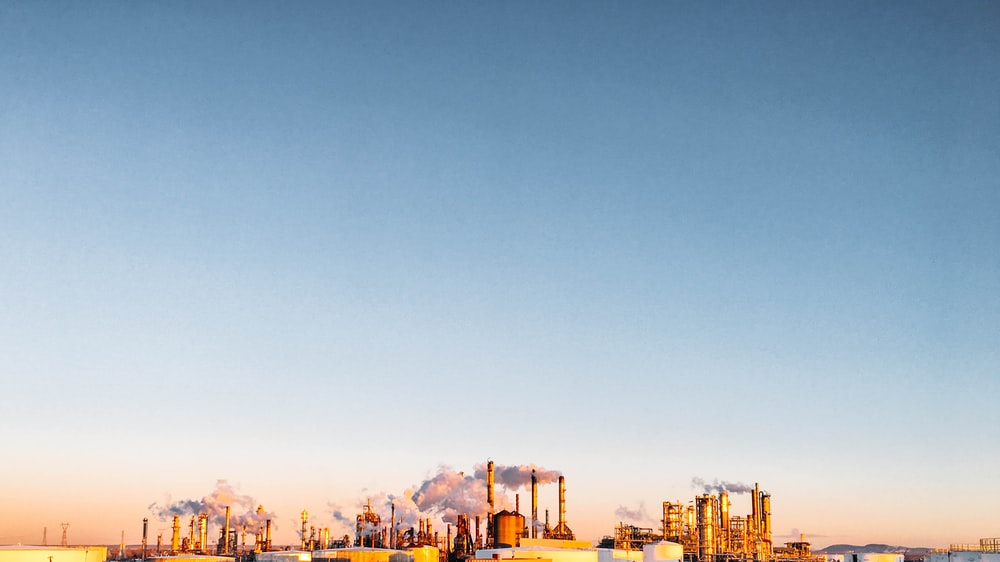 landscape photography of factory at daytime