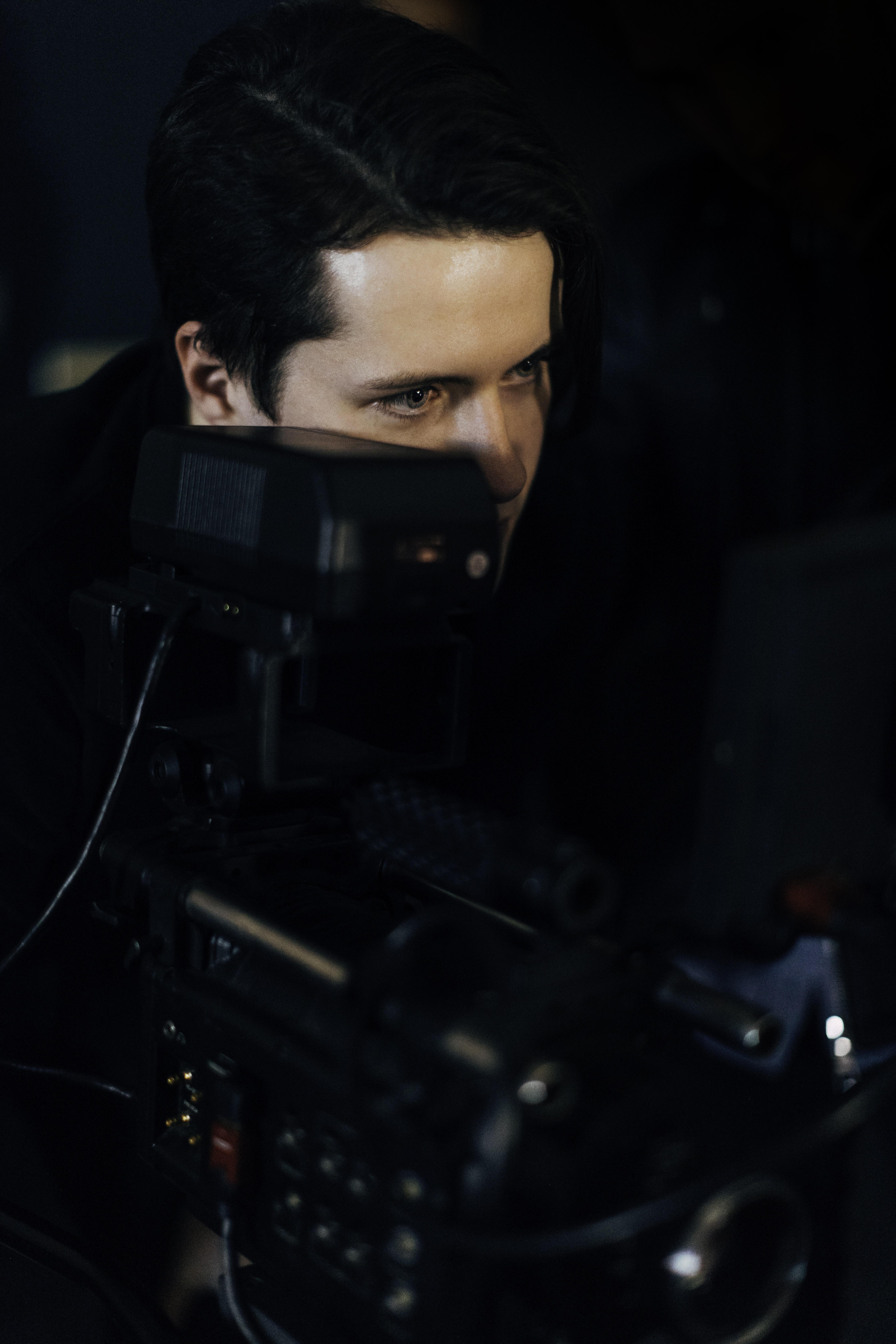 man looking at the monitor