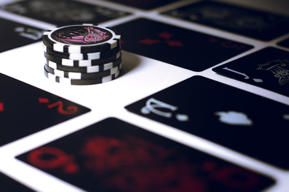 poker chip on white surface