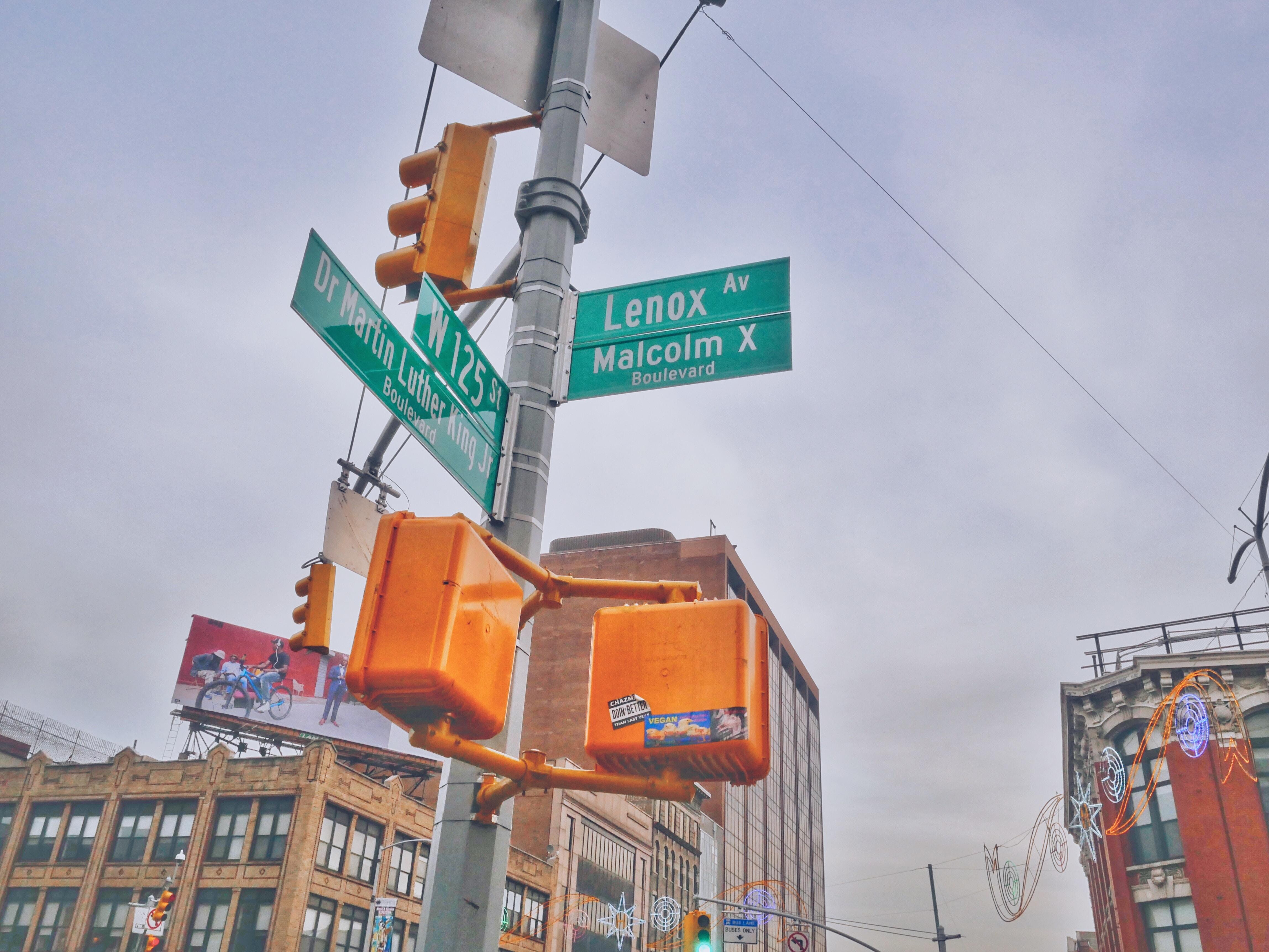 photography of street signage