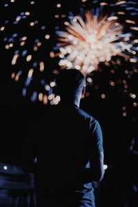 man looking at the fireworks