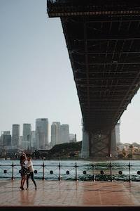 two people under bridge