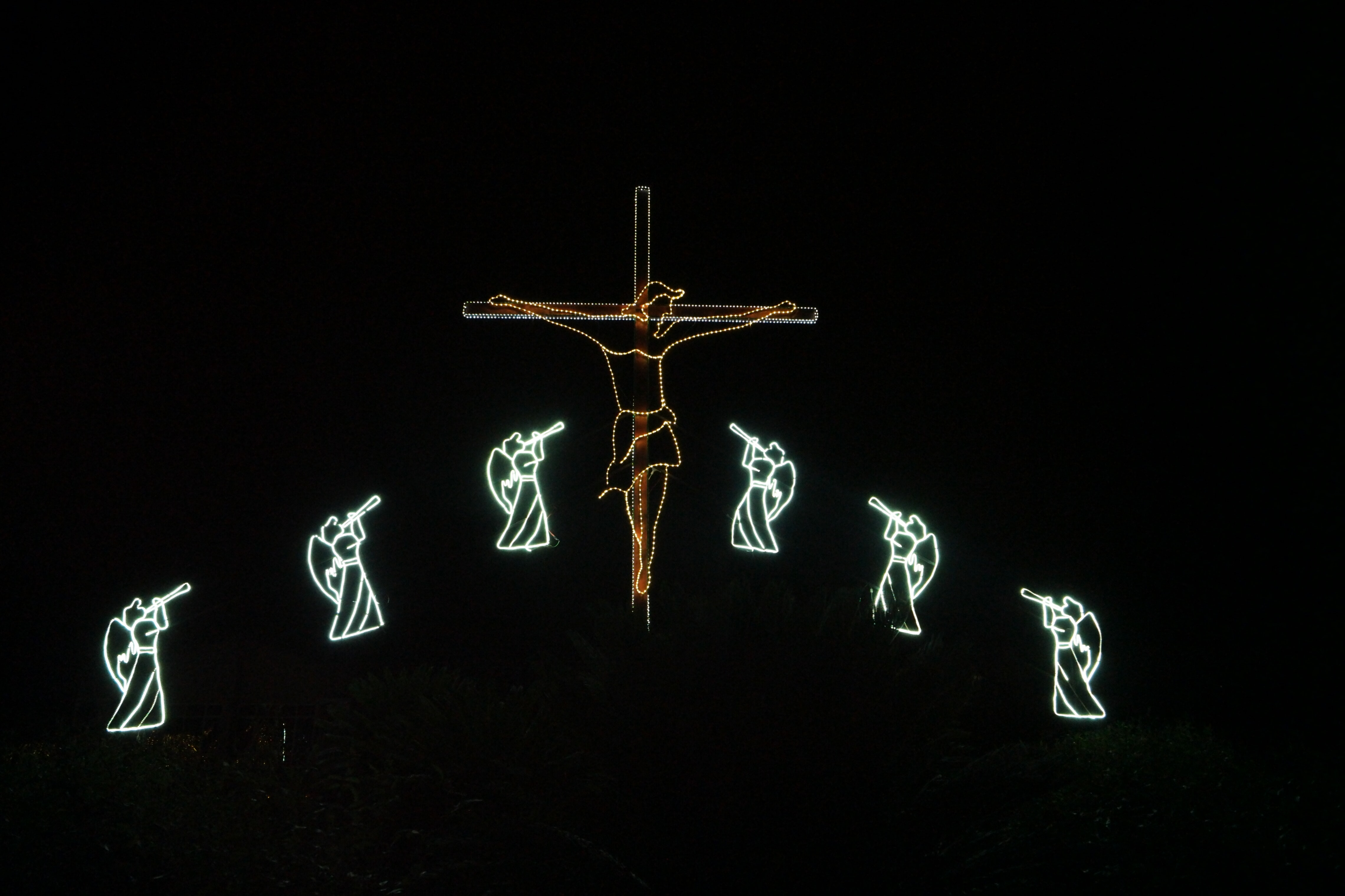 crucifix and angel lights