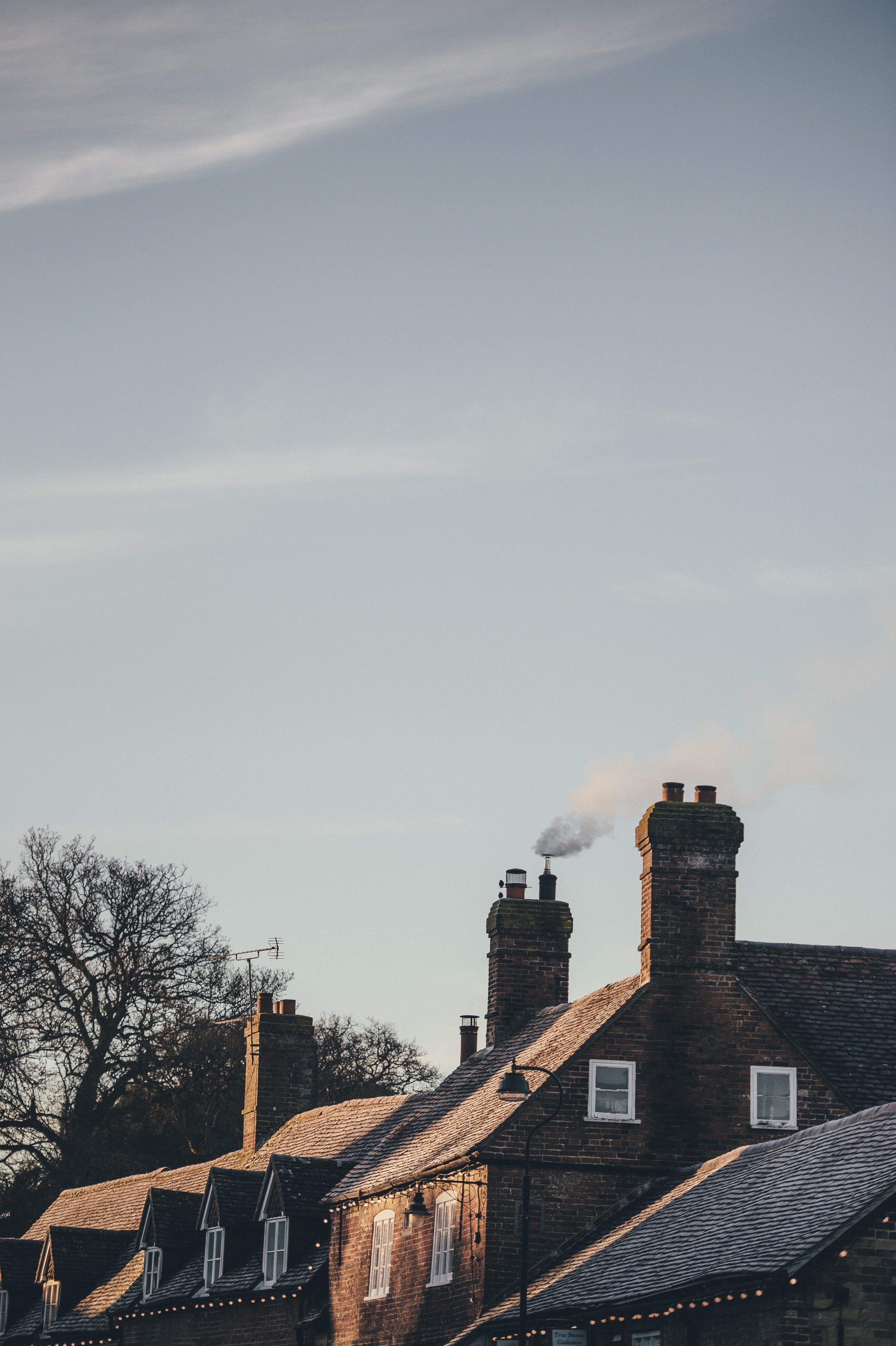 house with chimney smoke