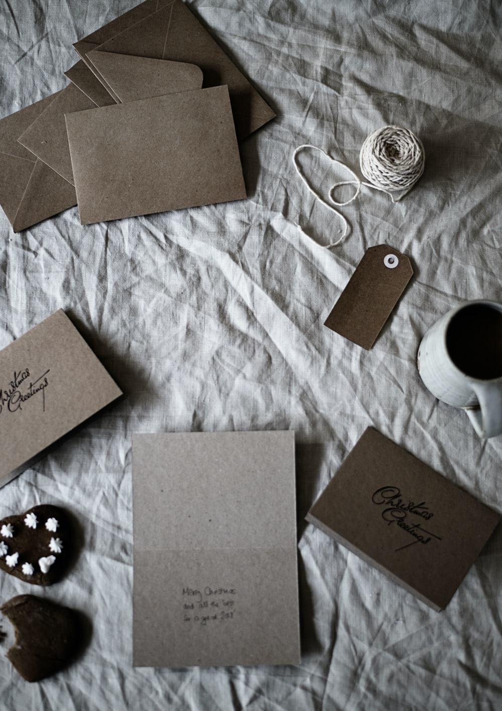 brown envelops on gray textile