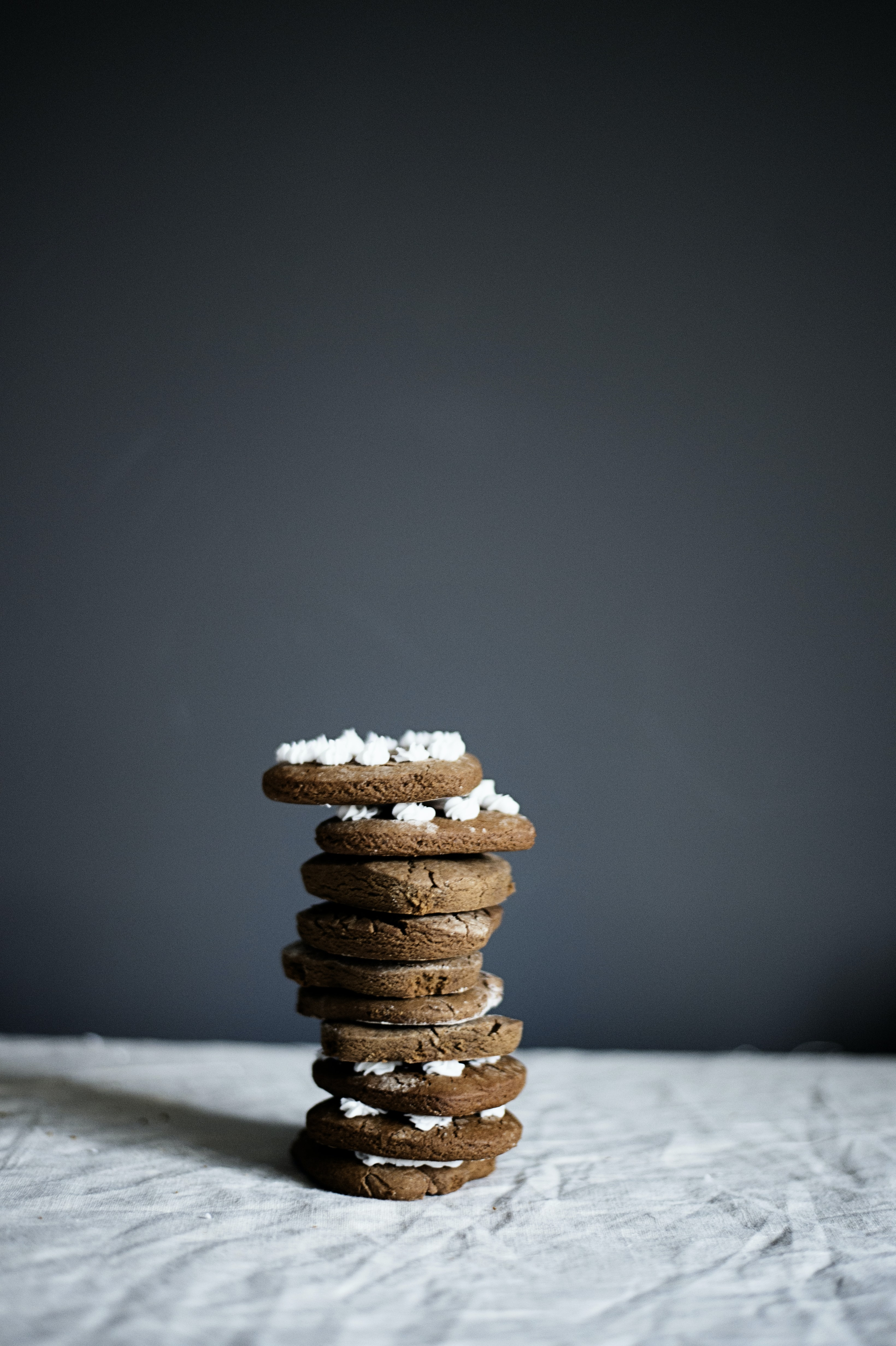 stacked cookies on grey surface