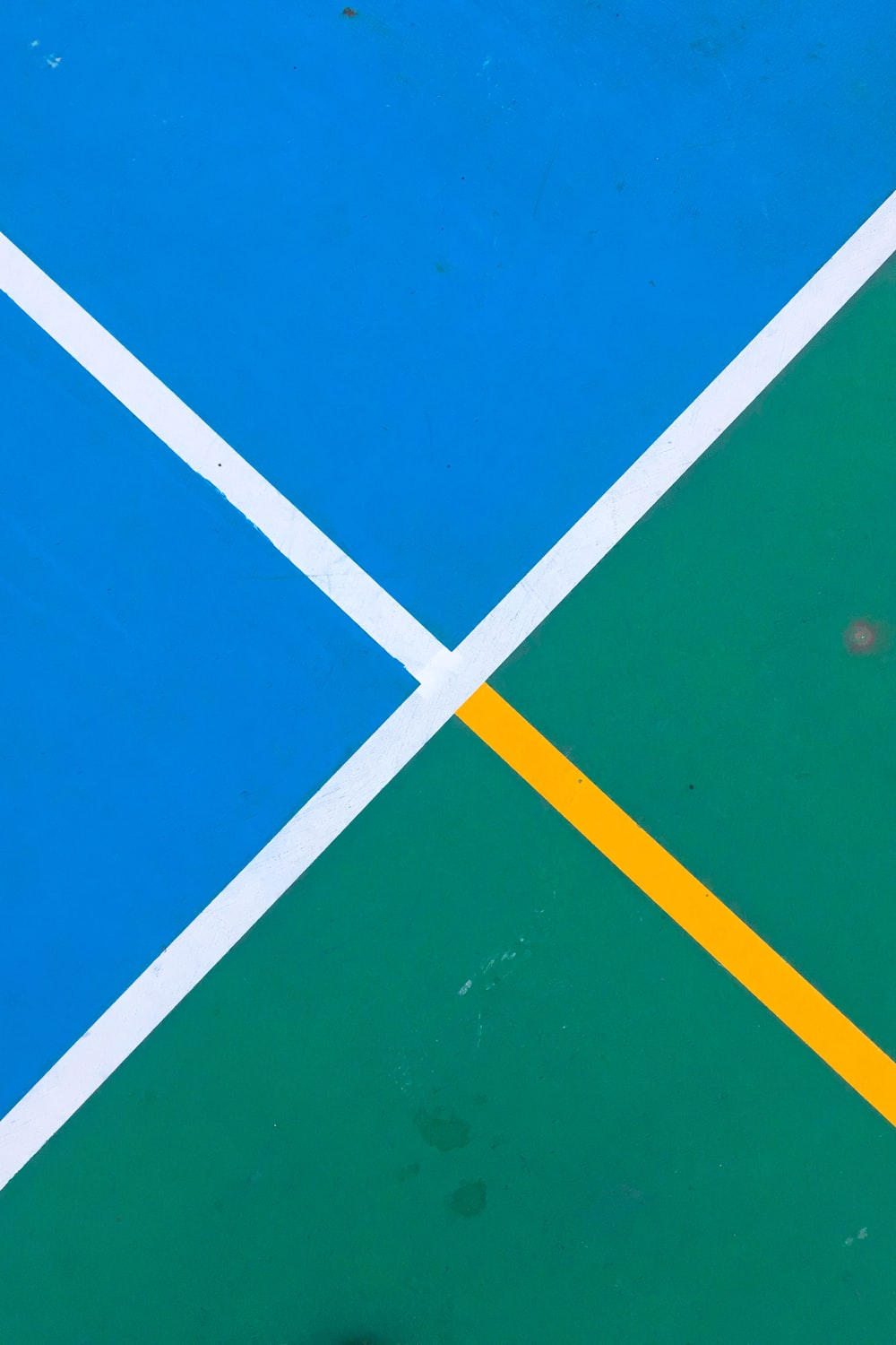 photo of blue and green pavement