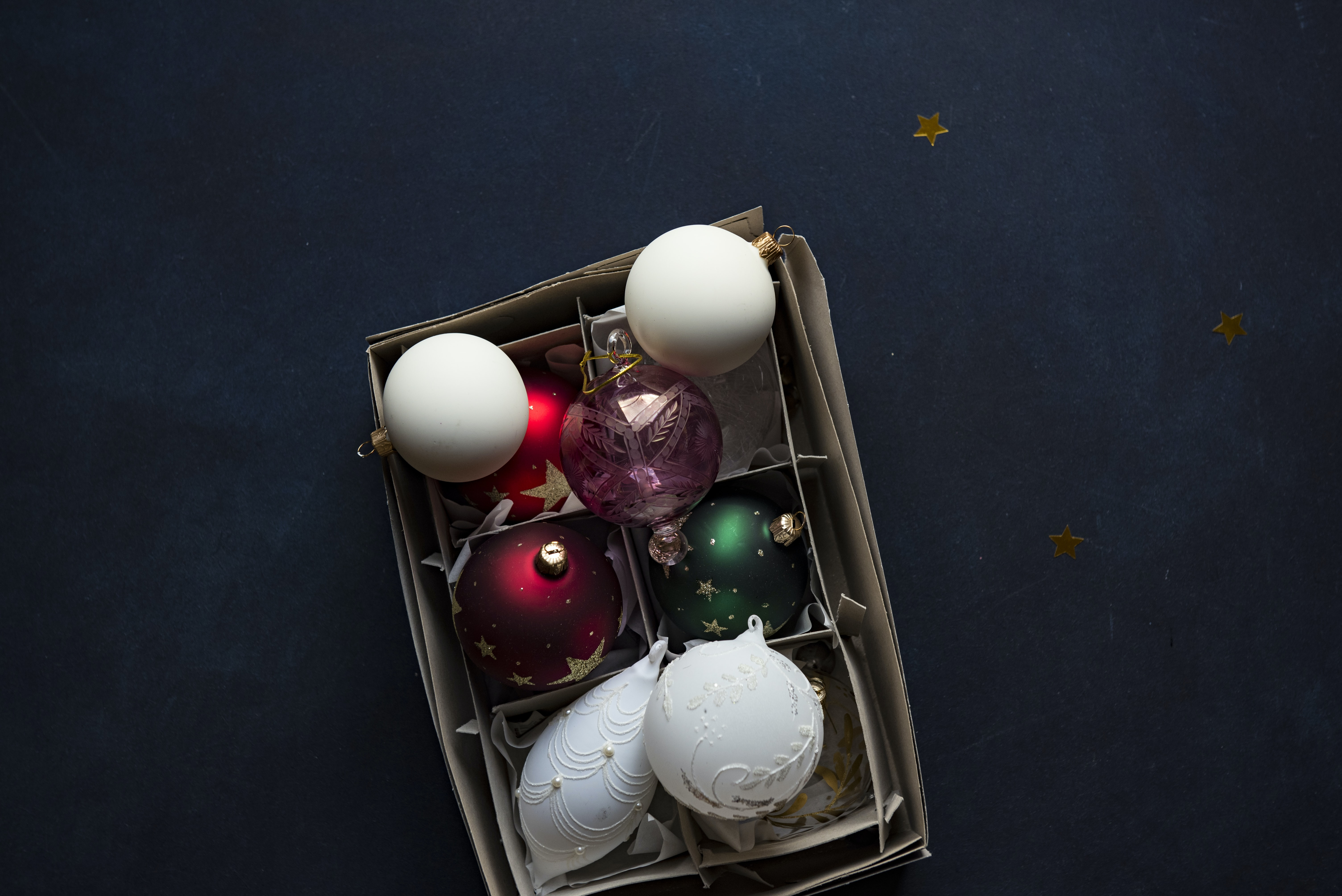 shallow focus photography of six assorted-color baubles