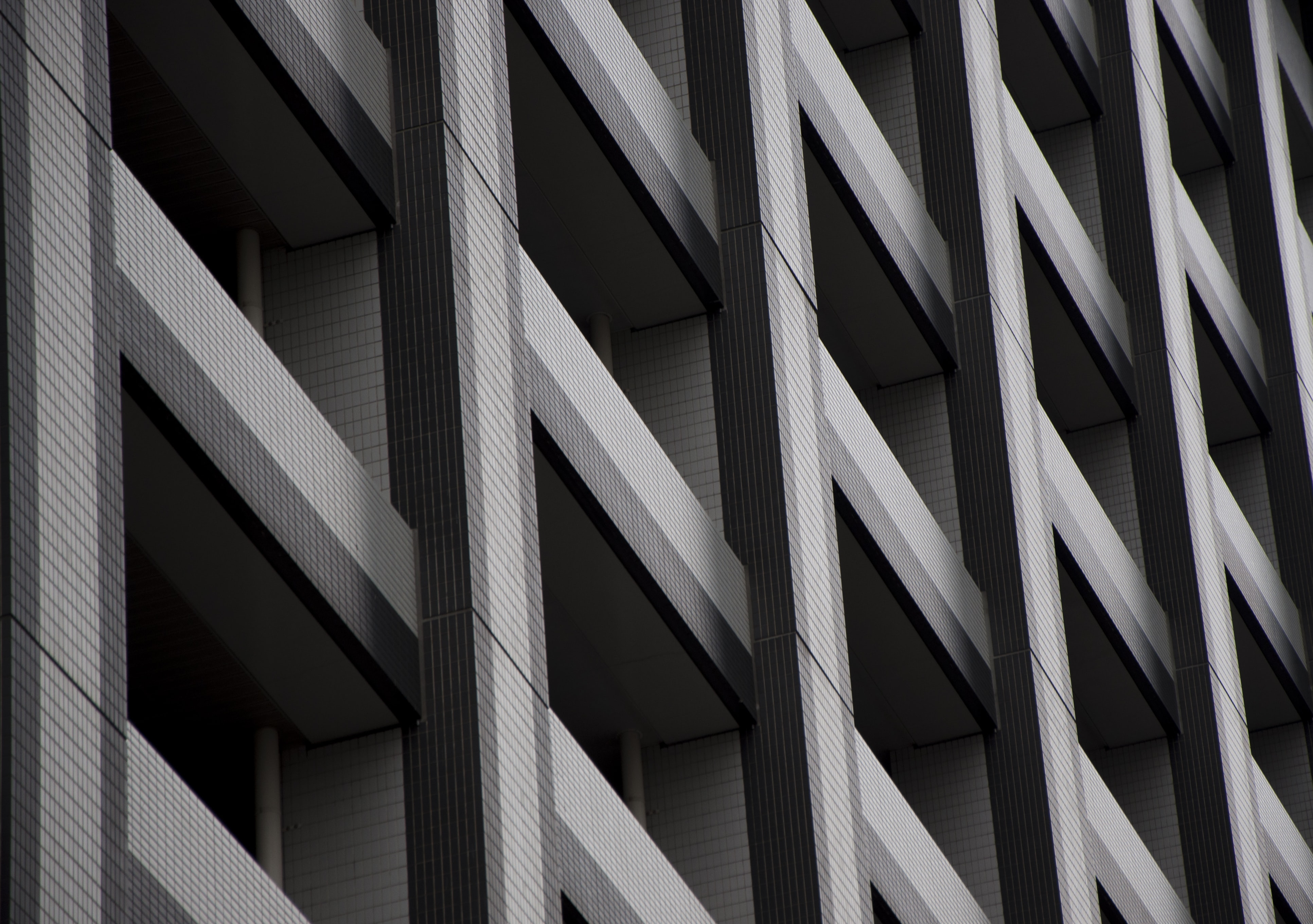 low angle photography of gray multi-story building