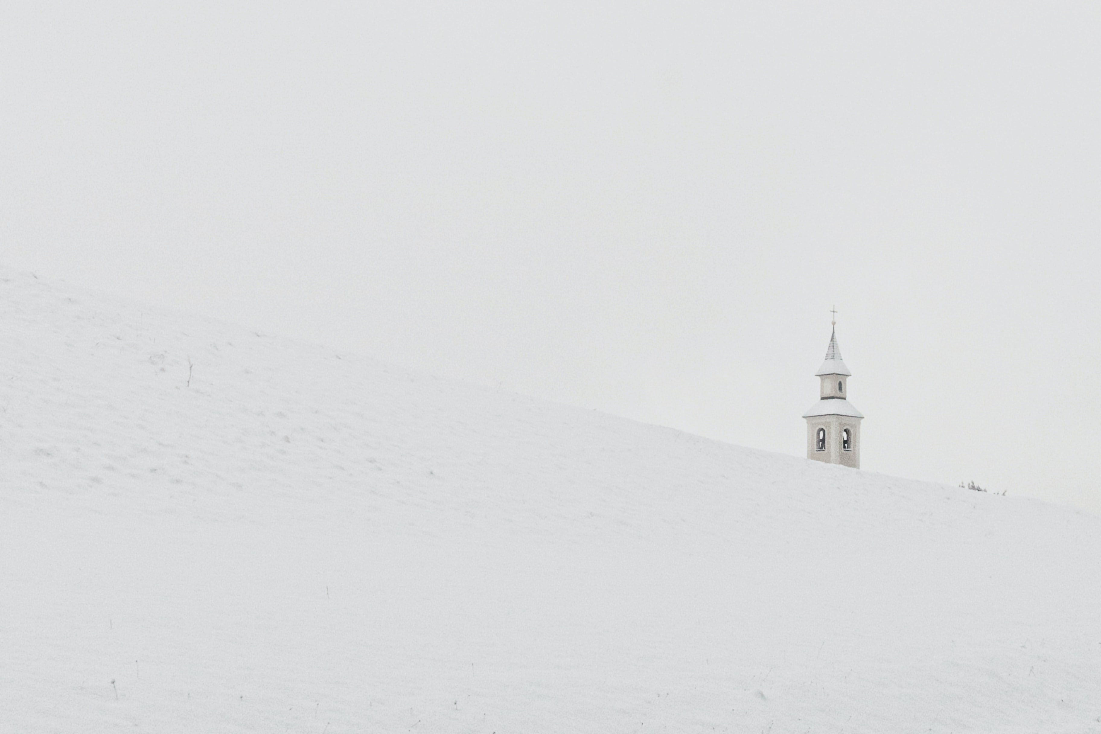gray concrete tower on pile of snow