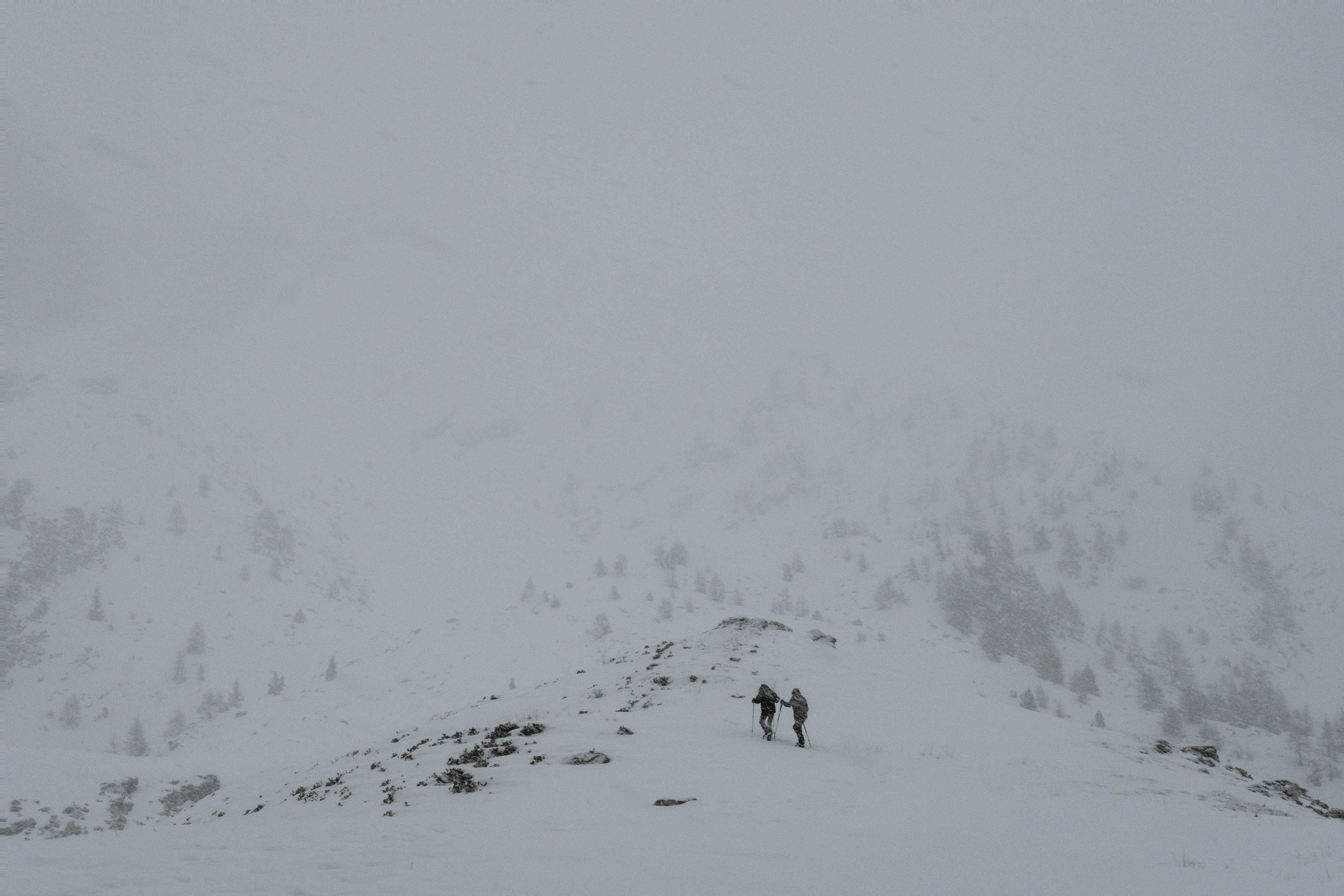 two people on mountain covered with snow