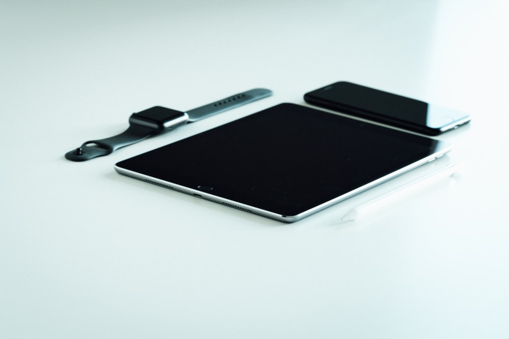 space gray iPad, iPhone, and Apple Watch
