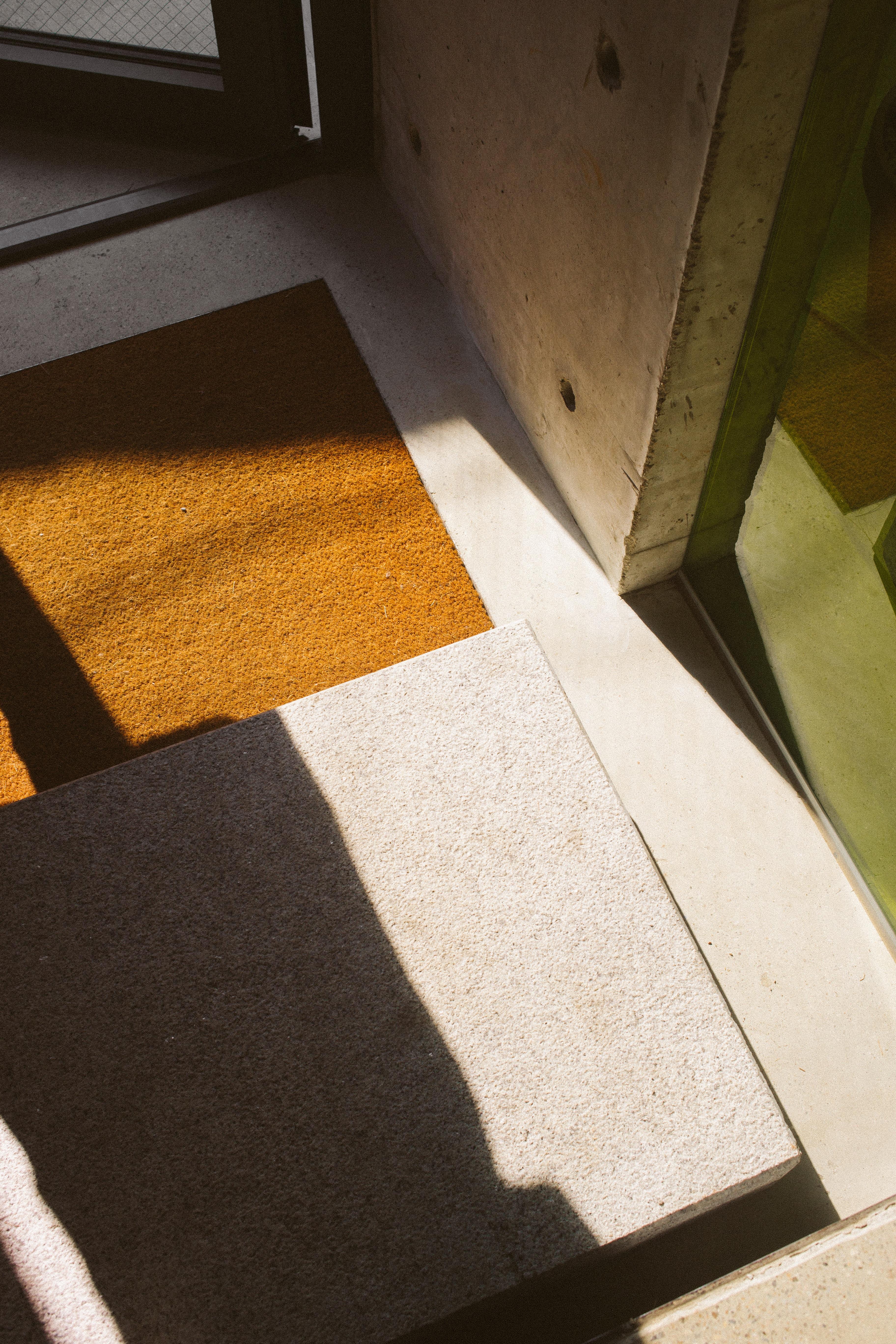 brown floor rug near opened door