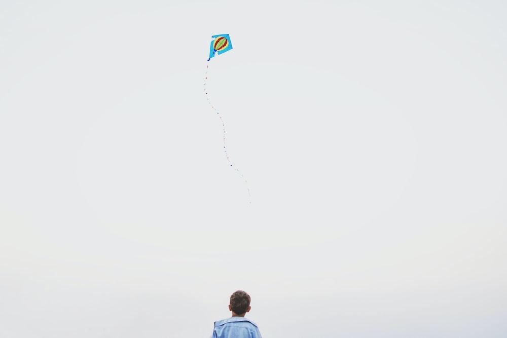 boy playing kite