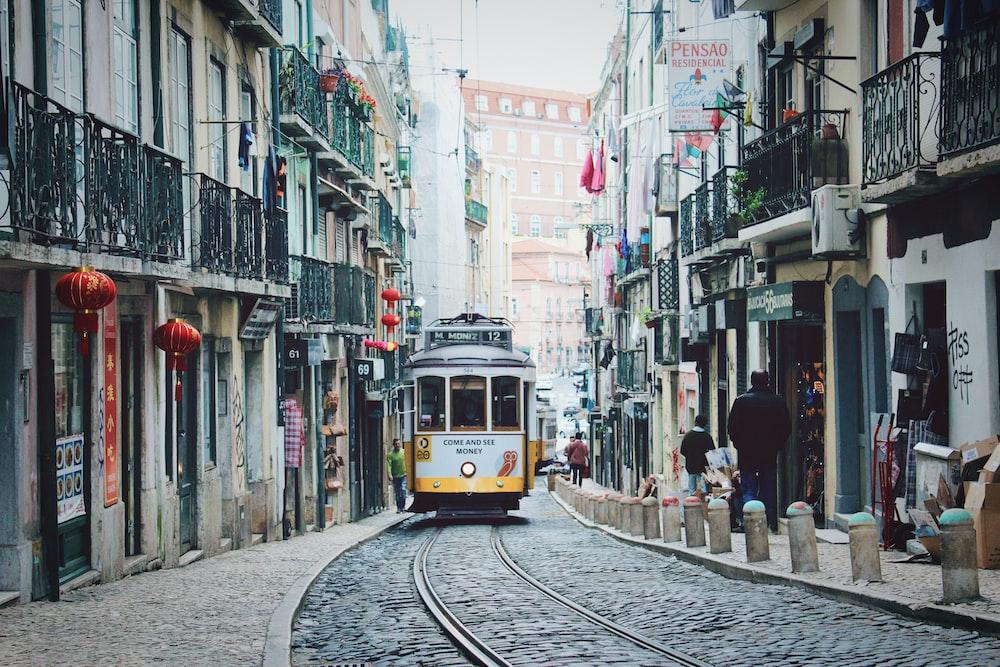 train passing in between buildings