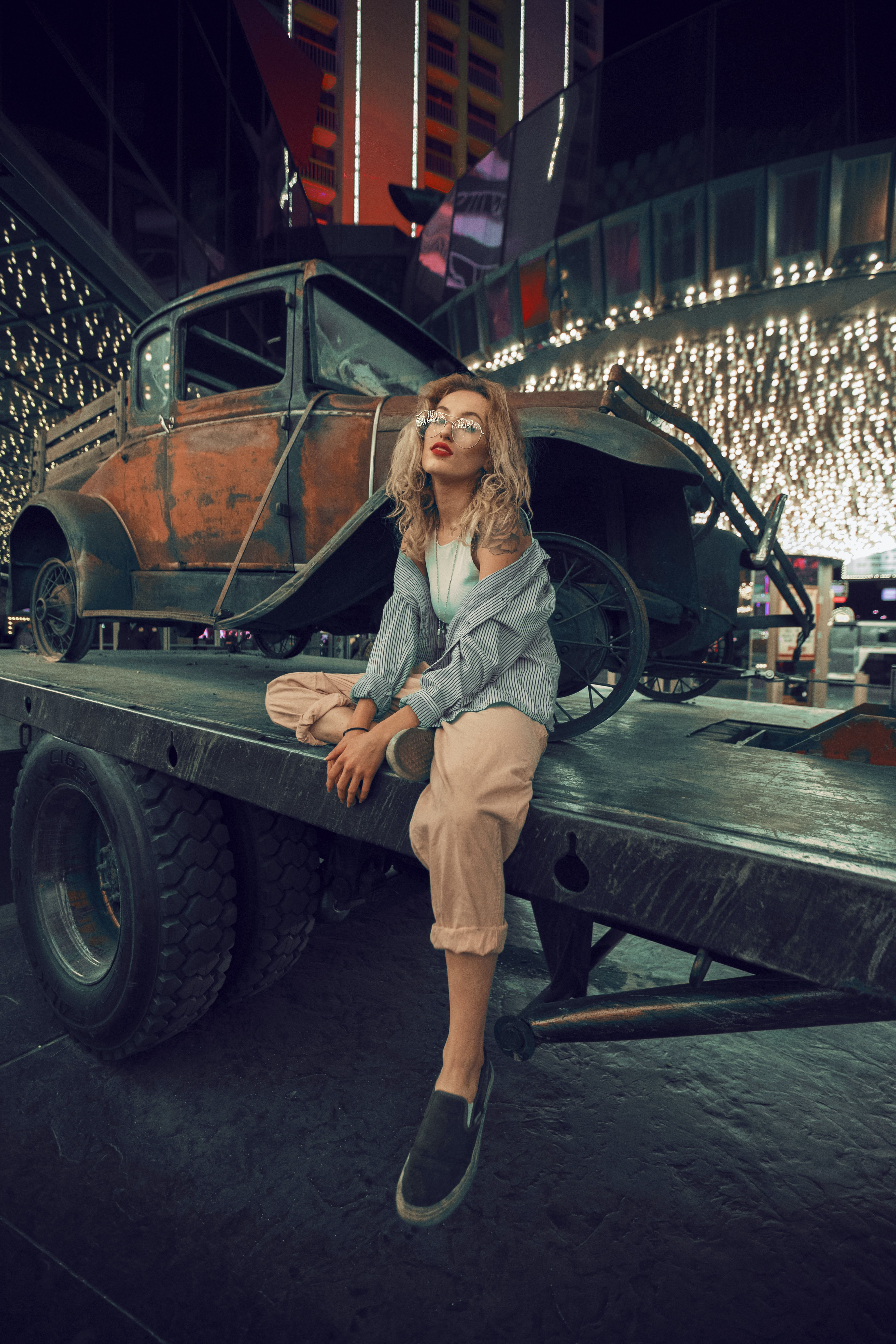 woman sitting on utility trailer during night