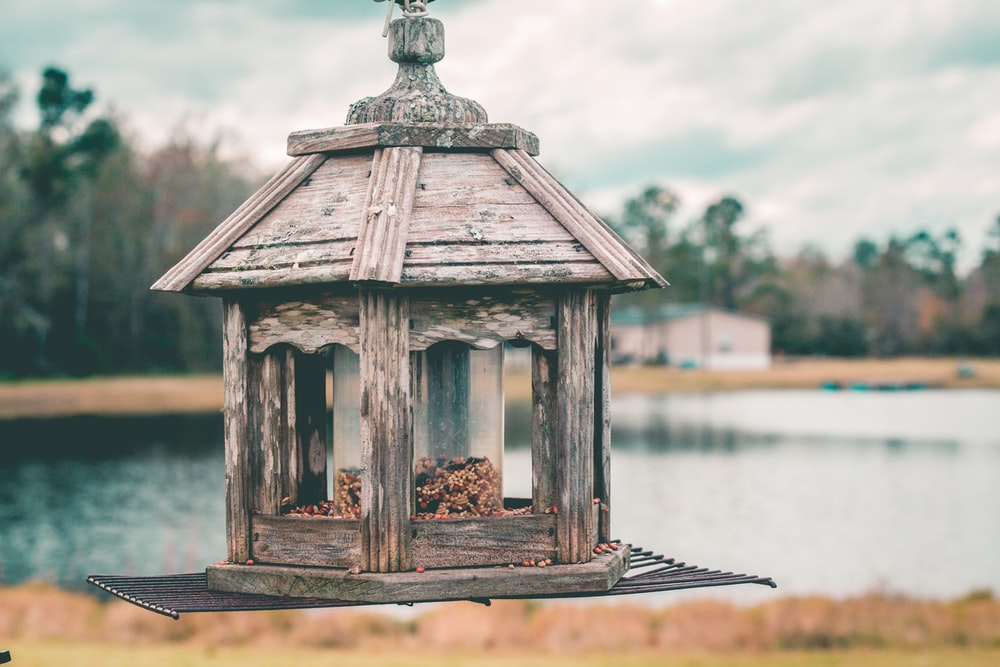 gray wooden candle lantern on mid air