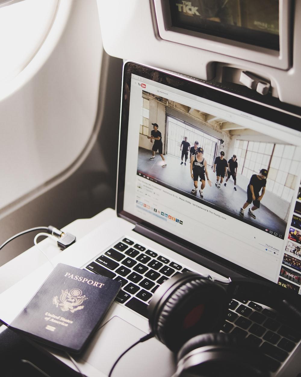 black headphones on MacBook Pro