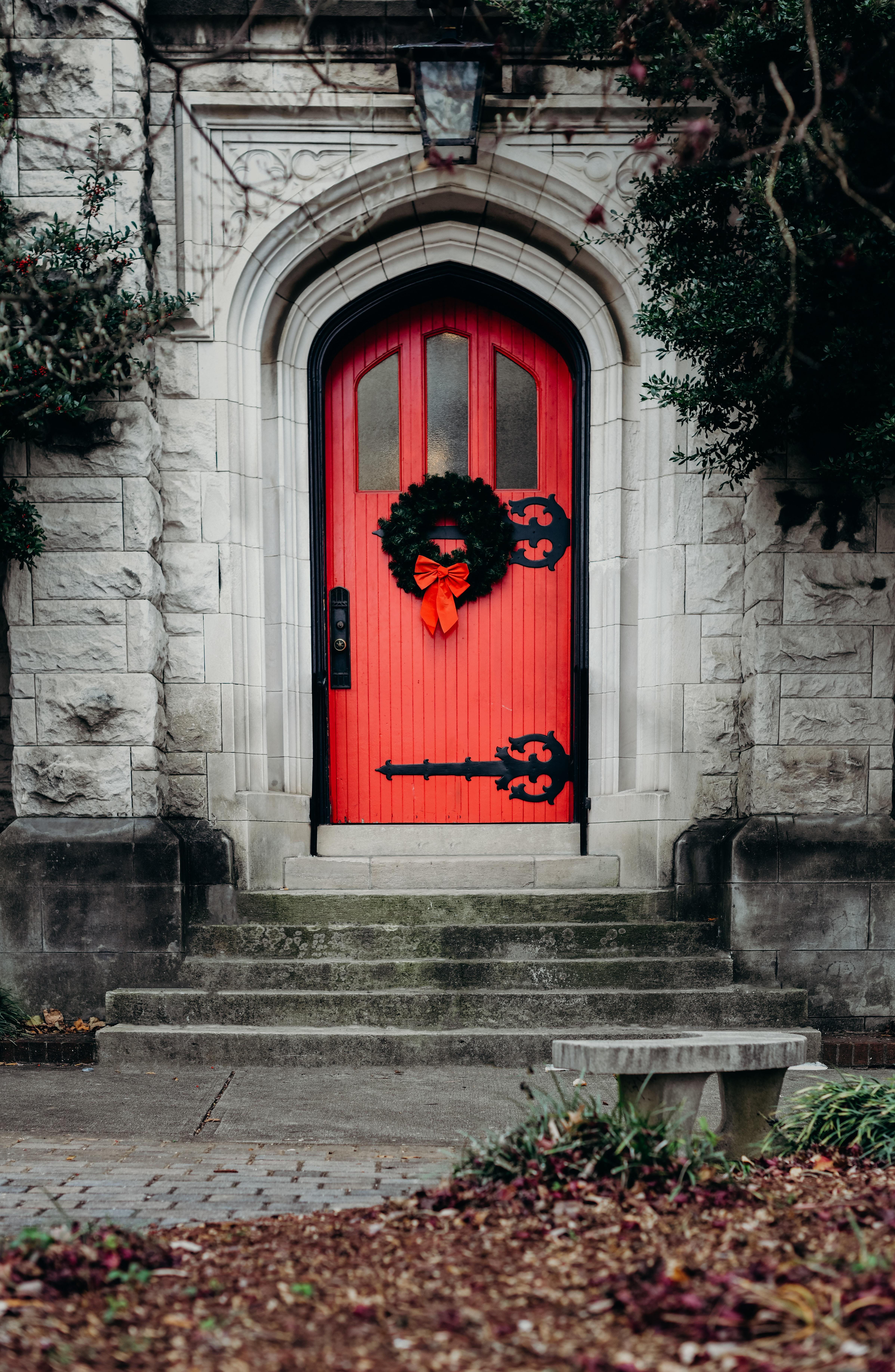 close-up photo of red wooden door