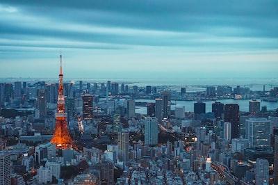 eiffel tower, paris during dusk tokyo teams background