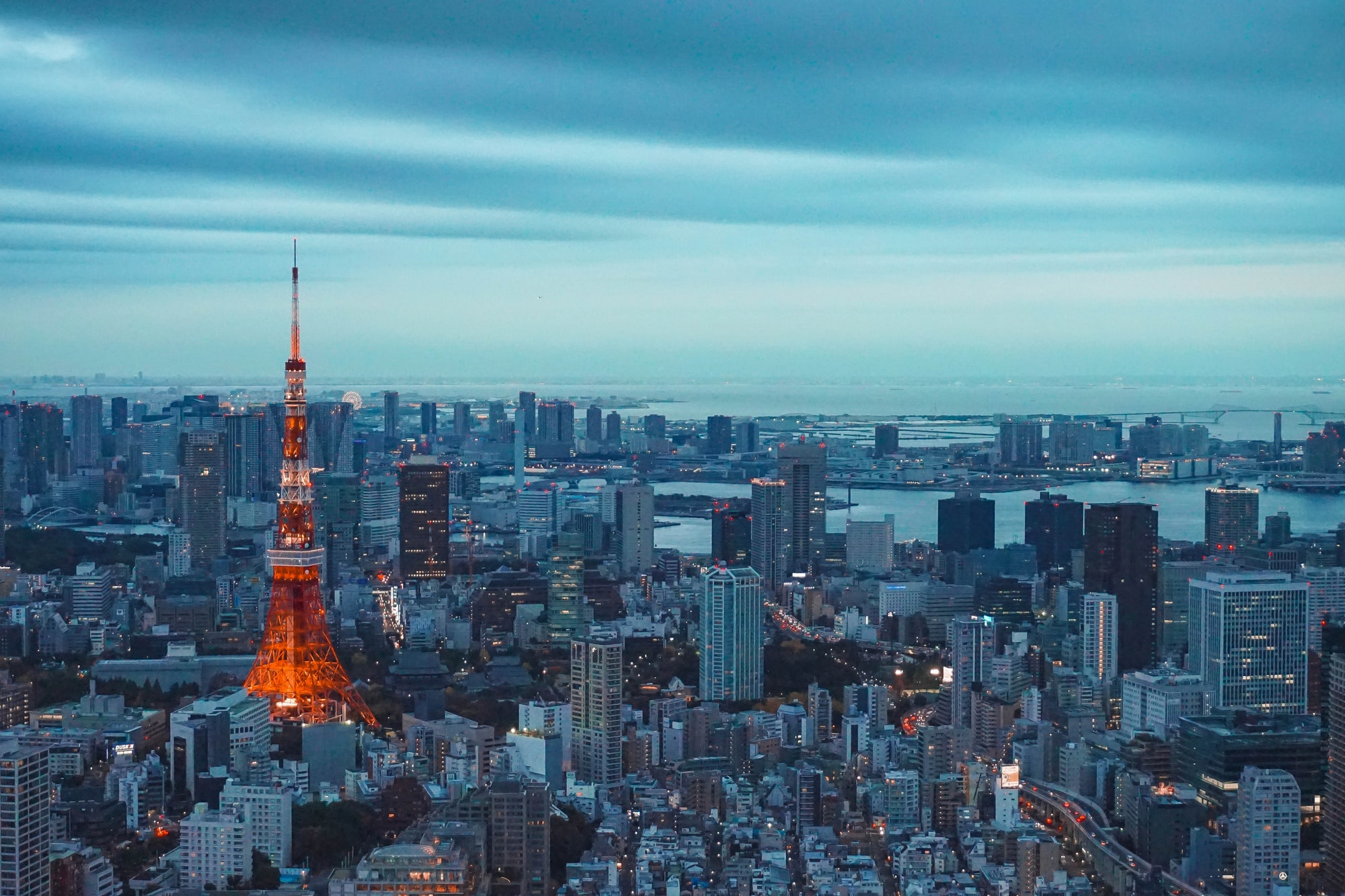 The best place to take a photo of the Tokyo Tower is at the viewing deck of Mori building in Roponggi Hills
