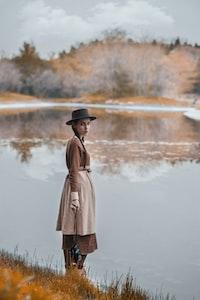 woman near body of water