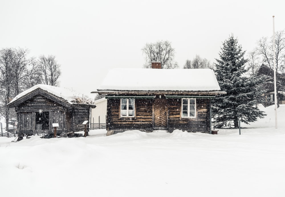 brown snow covered house
