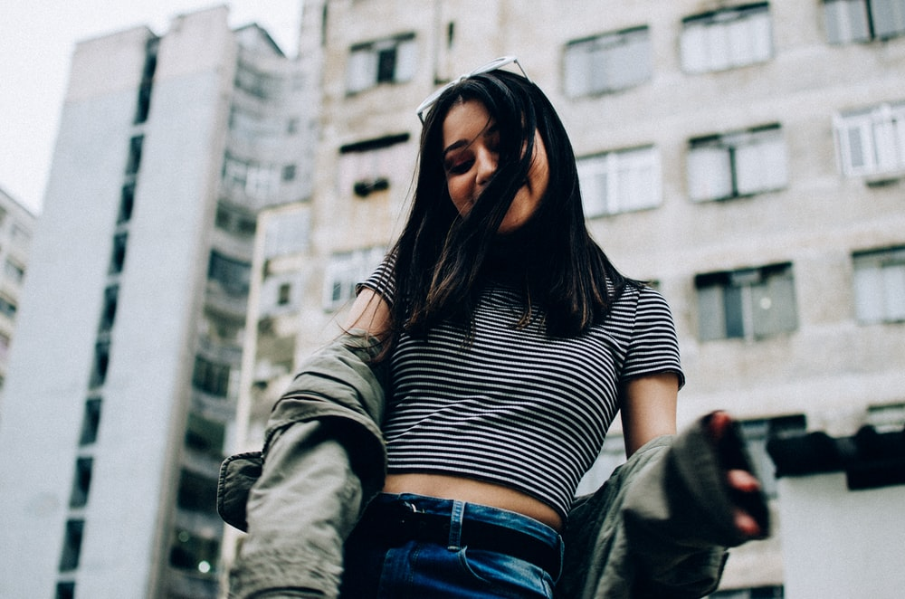 woman wearing striped crop-top and jacket