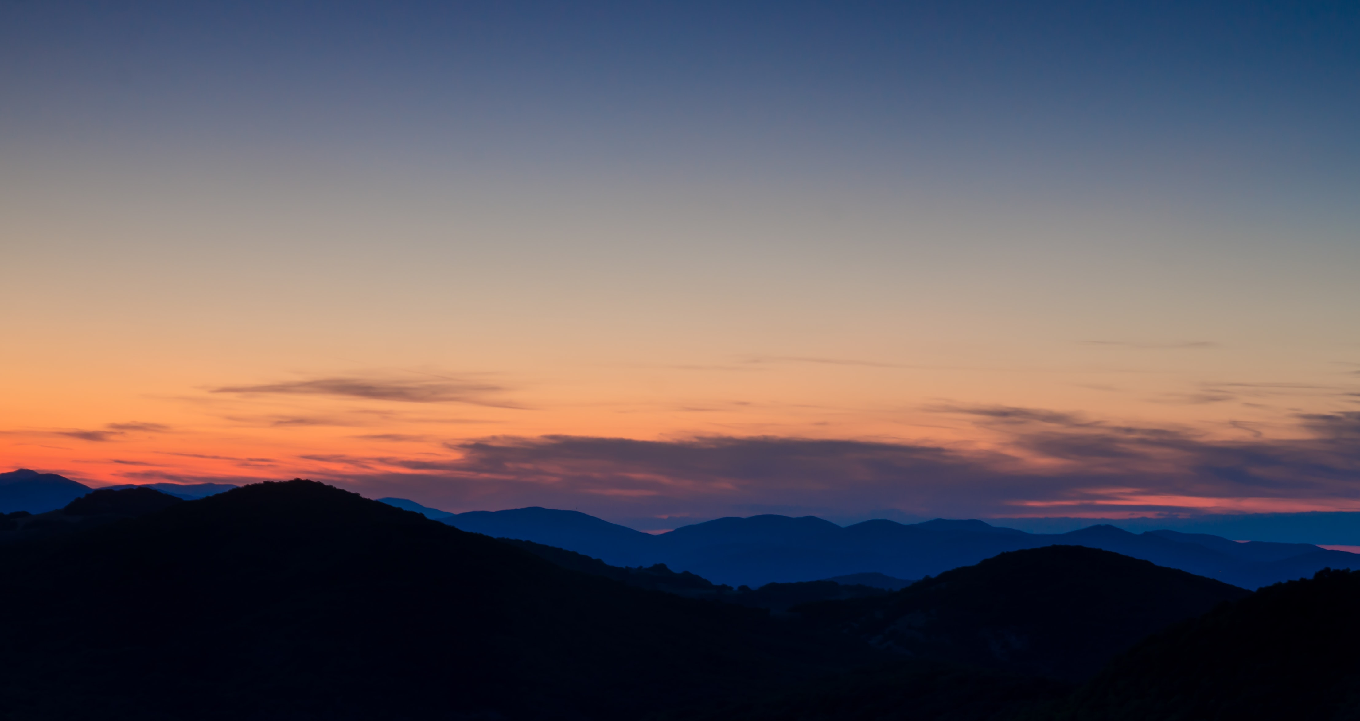 silhouette of mountain cliffs