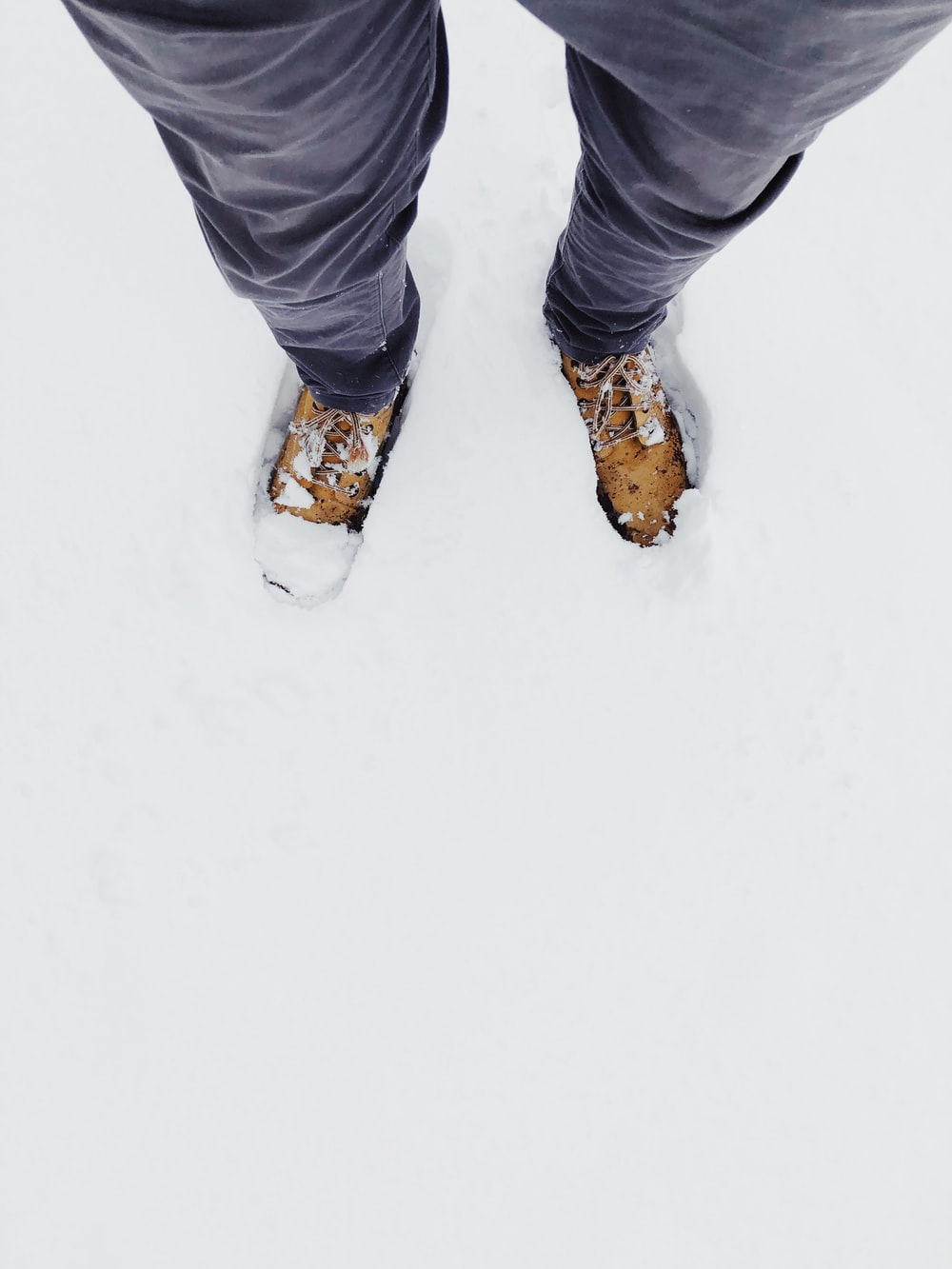 man standing on snow field