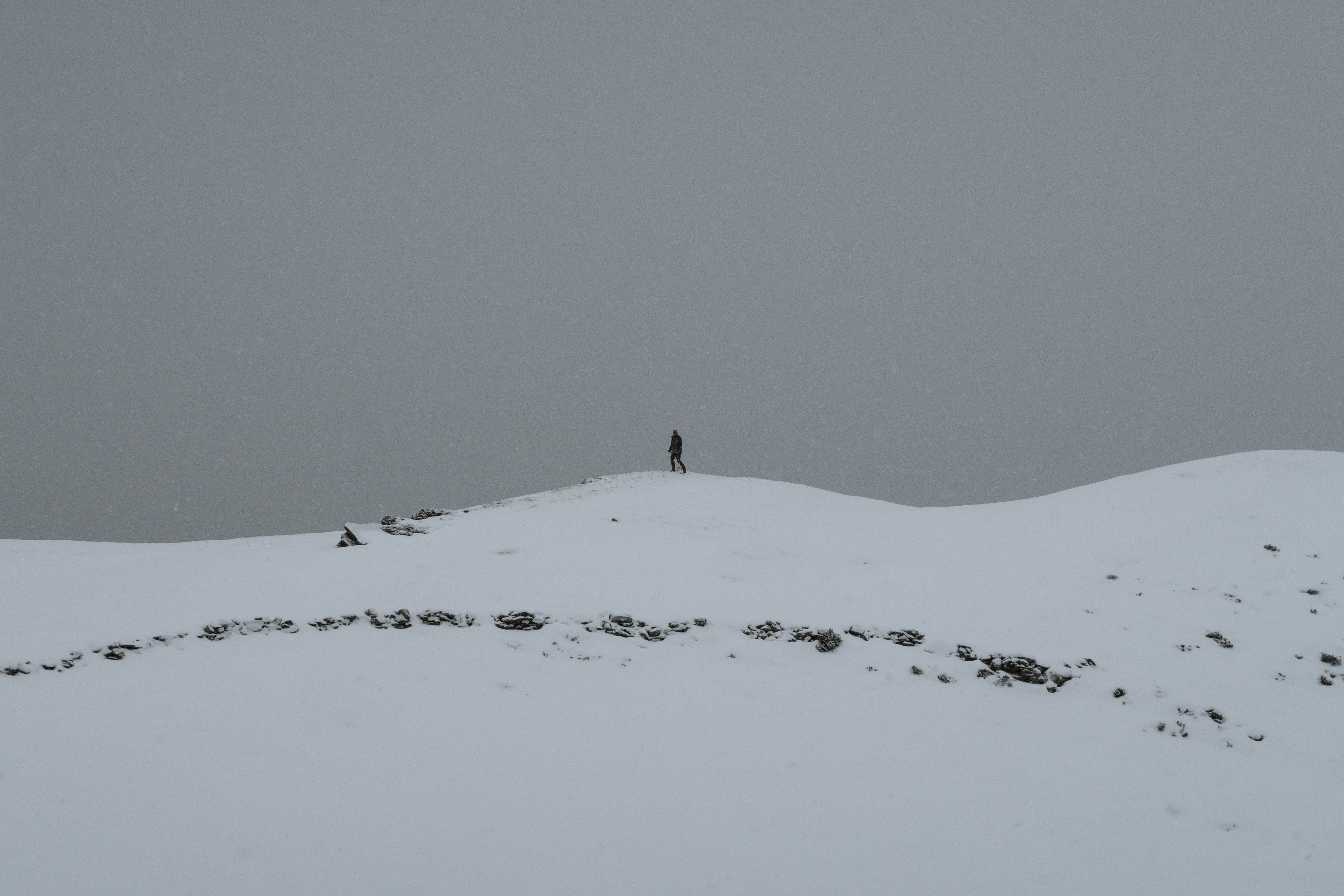 person walking on snow at daytime