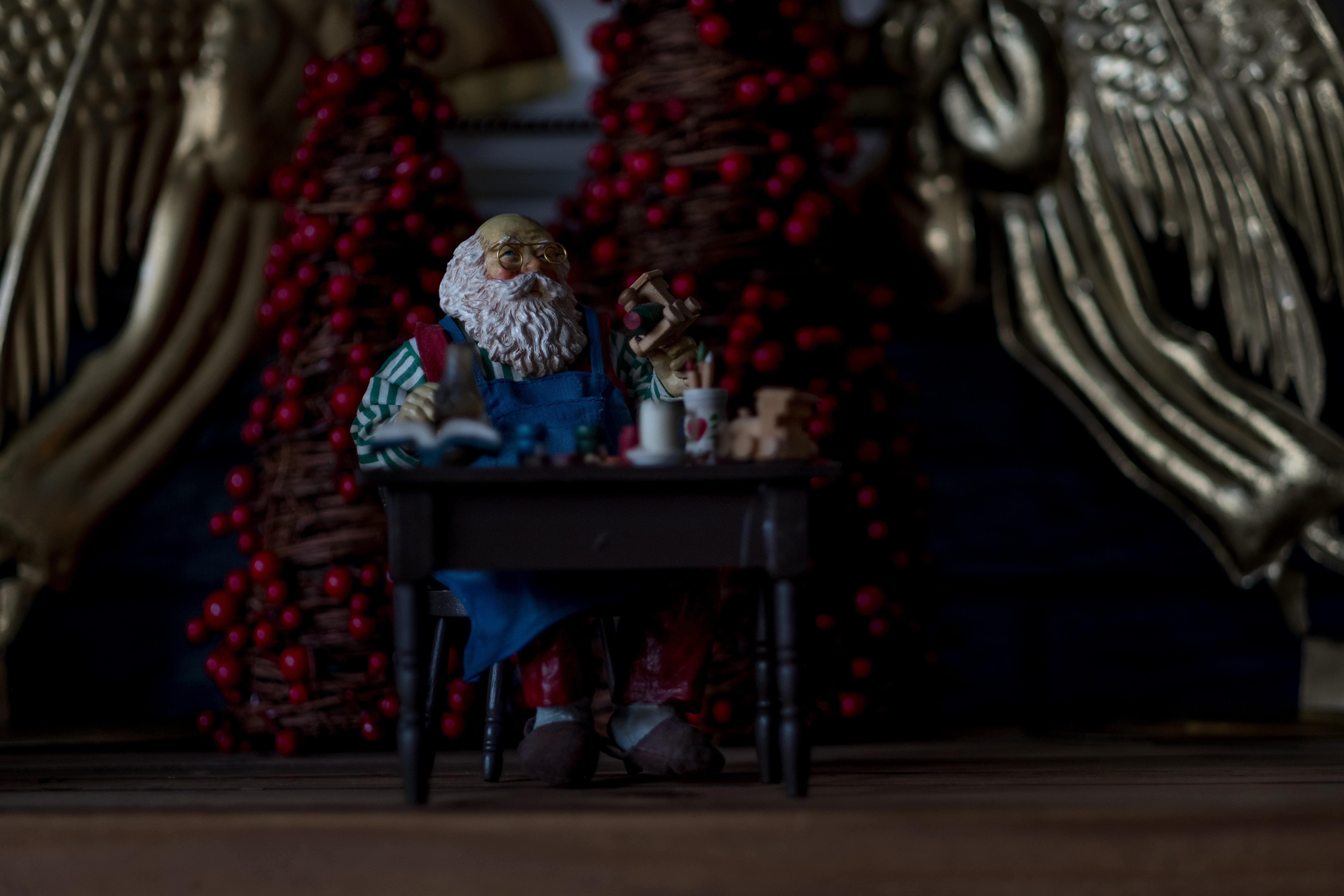 grandfather sitting beside table figurine
