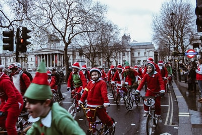 group of children in bicycle near white building elf teams background