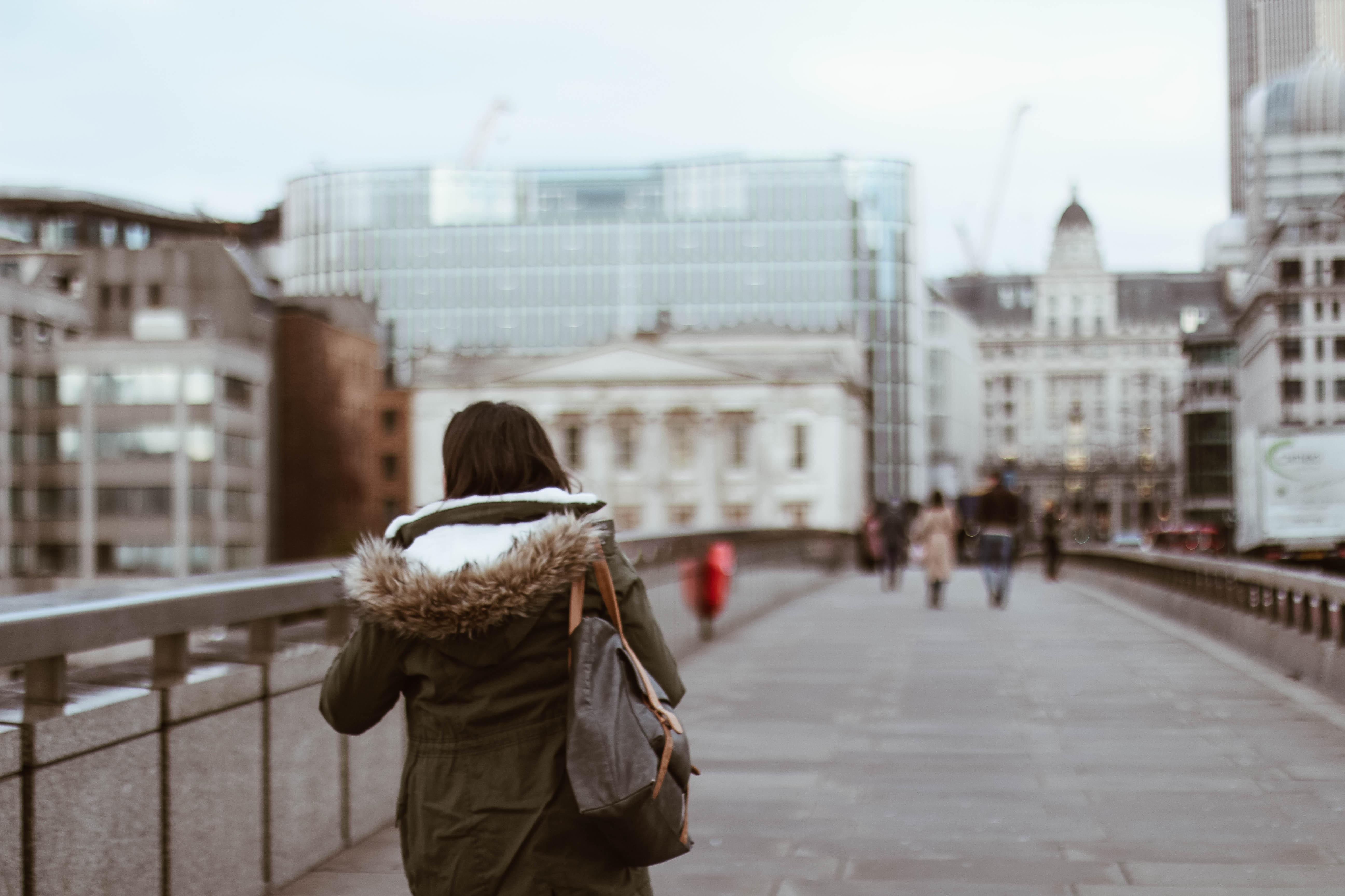 shallow focus photography of woman in green coat
