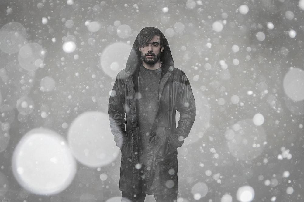 bokeh photography of man wearing coat