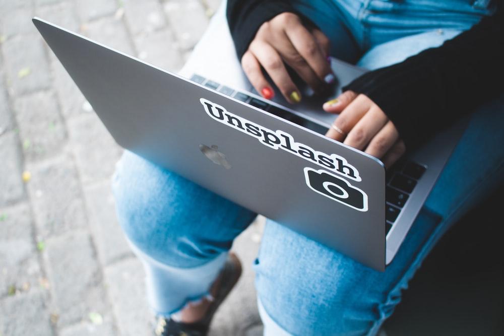 person holding gray laptop