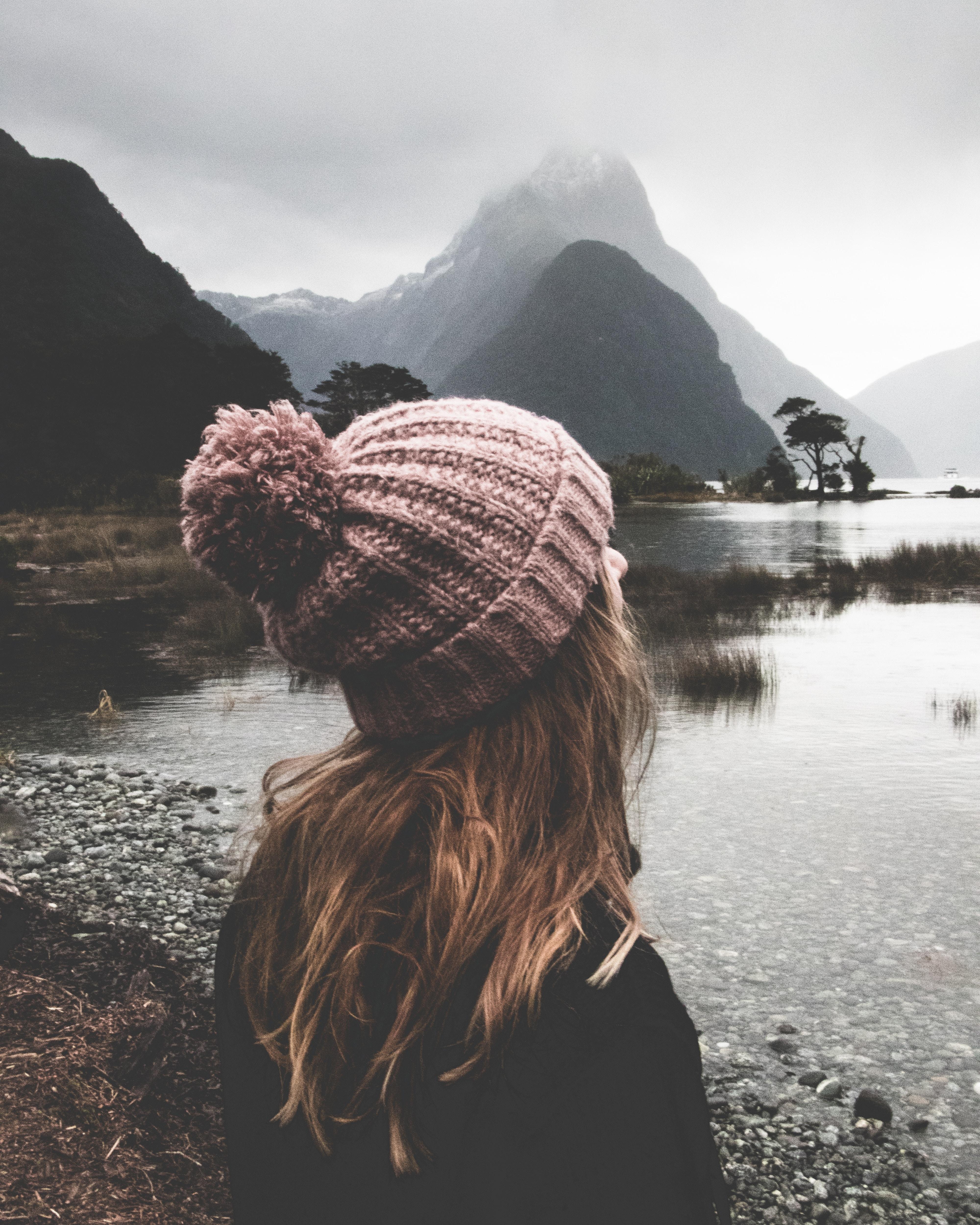 woman watching body of water during daytime
