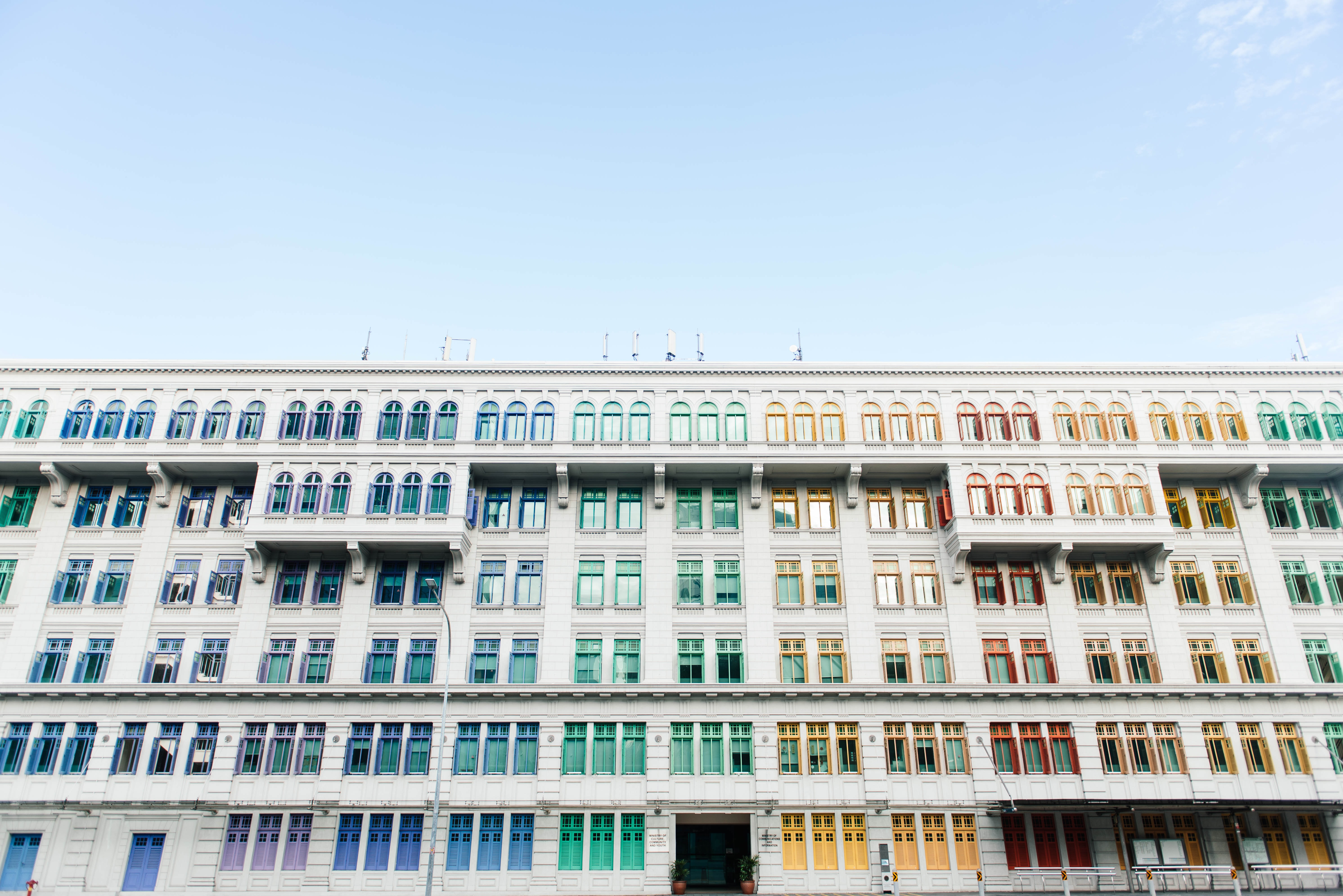 white and multicolored window building at daytime