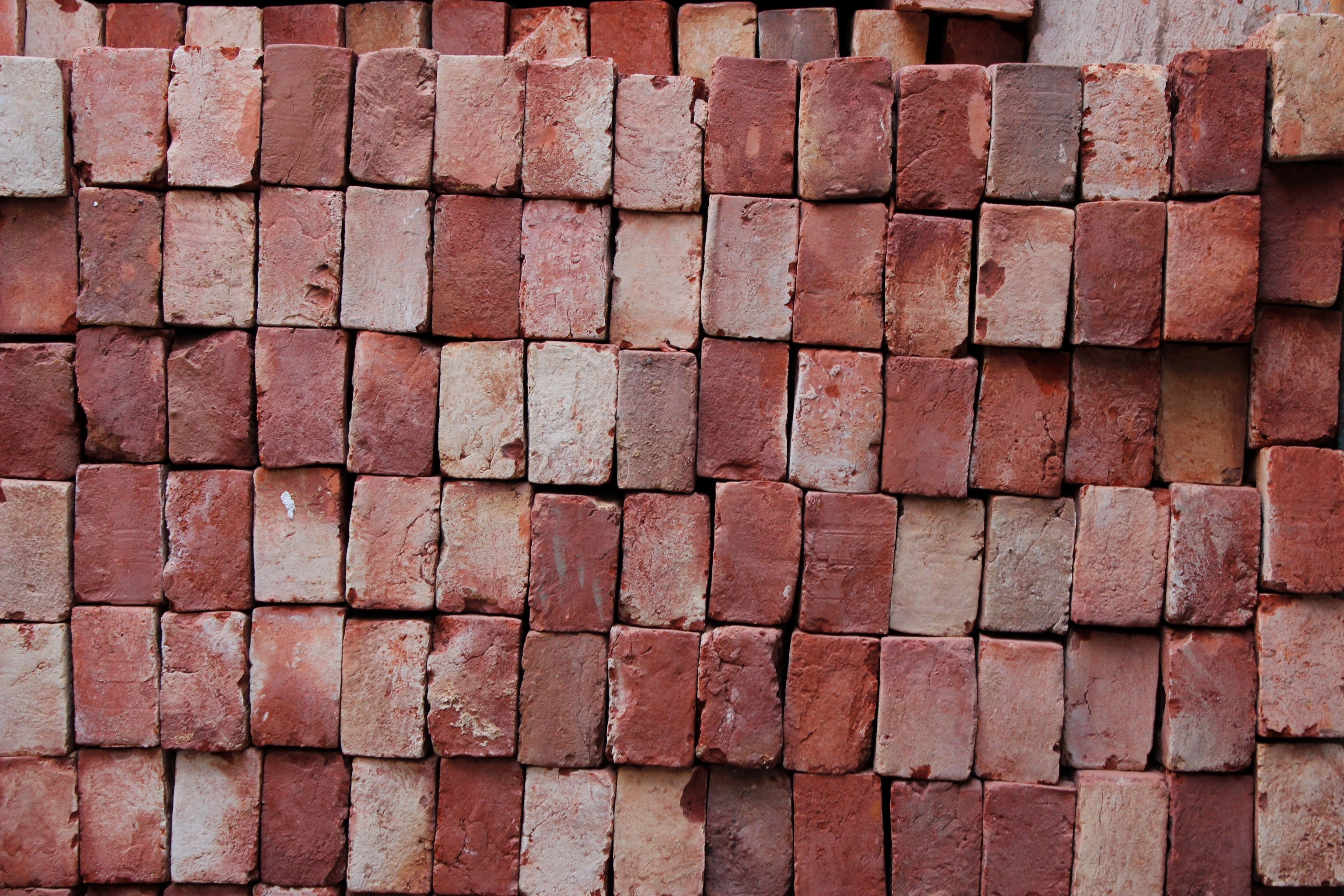 brown brick wall closeup photography