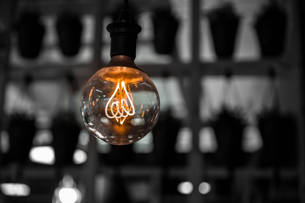 macro photography of clear light bulb