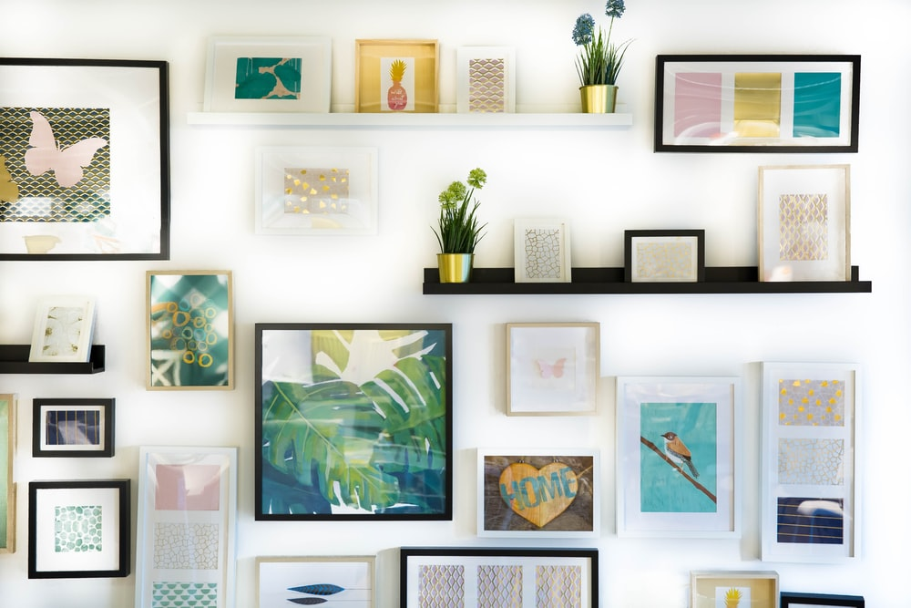 assorted-color framed paintings on the wall
