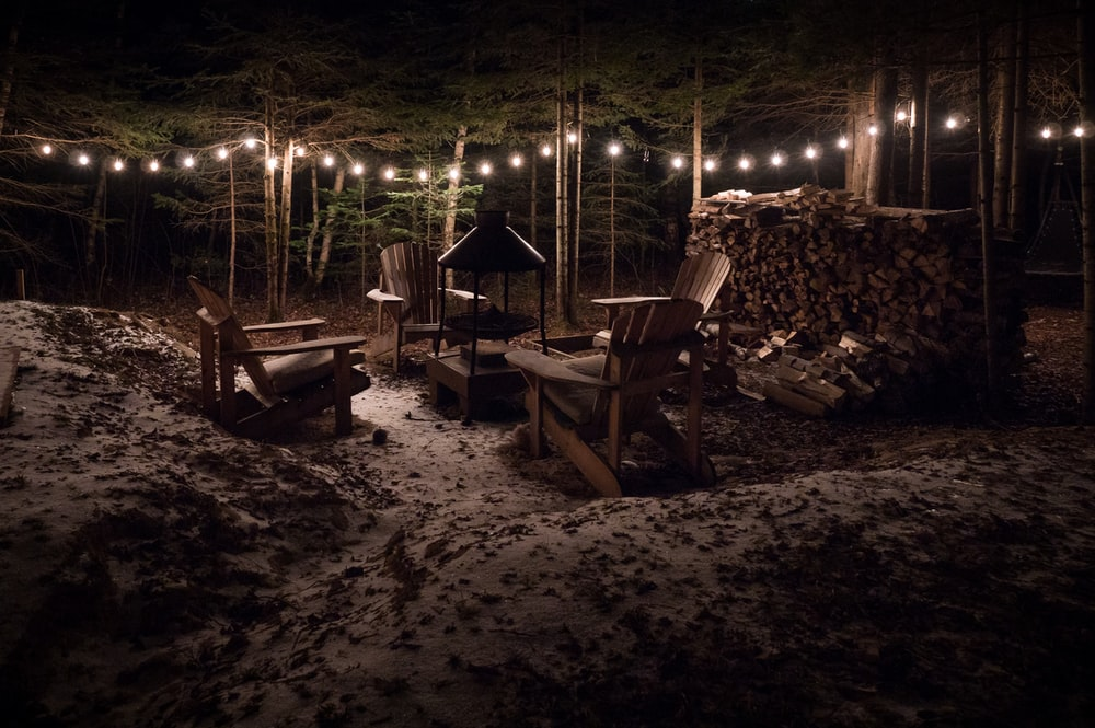 brown wooden adirondack chair on night time