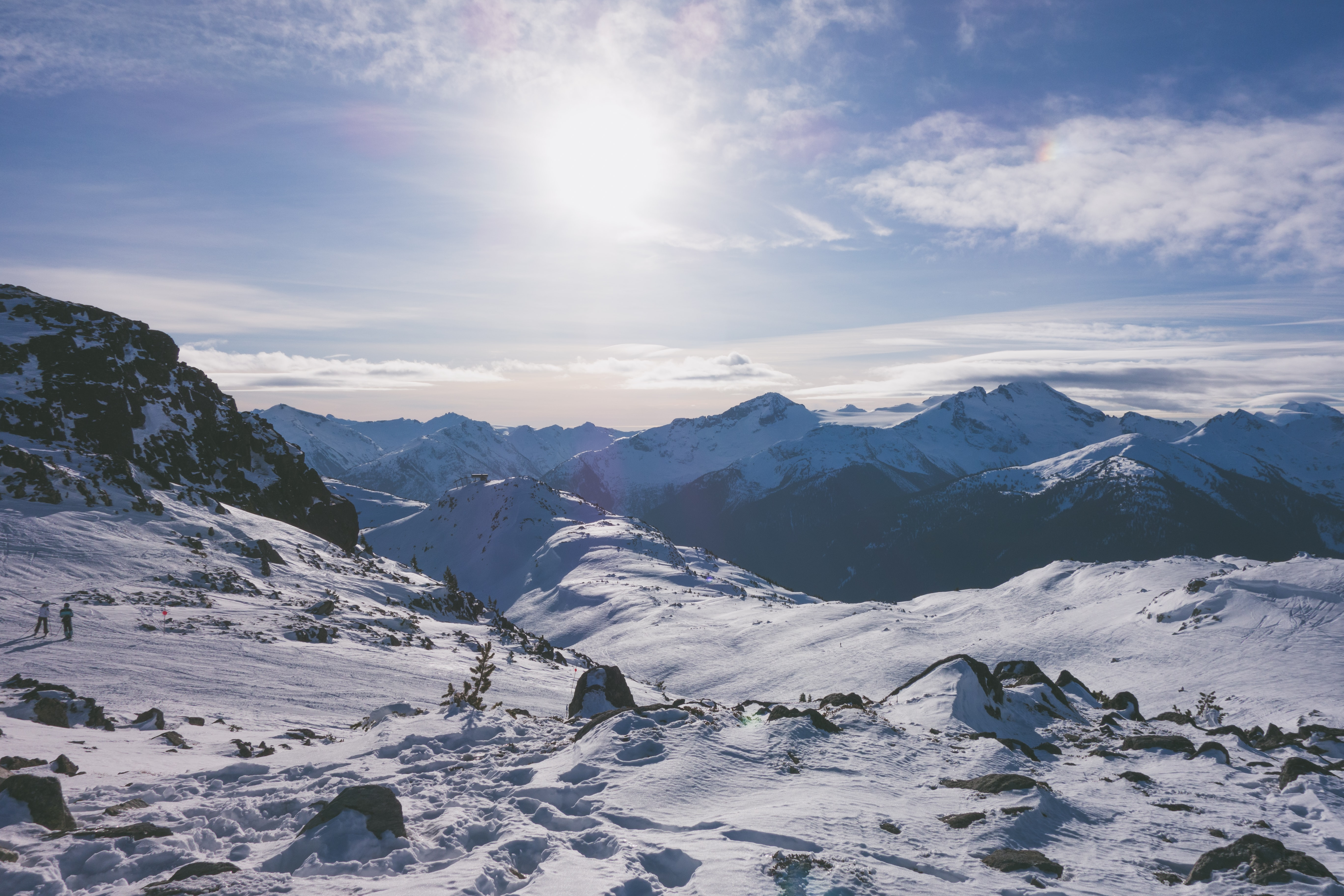 group of people standing on top snowy mountain during daytime