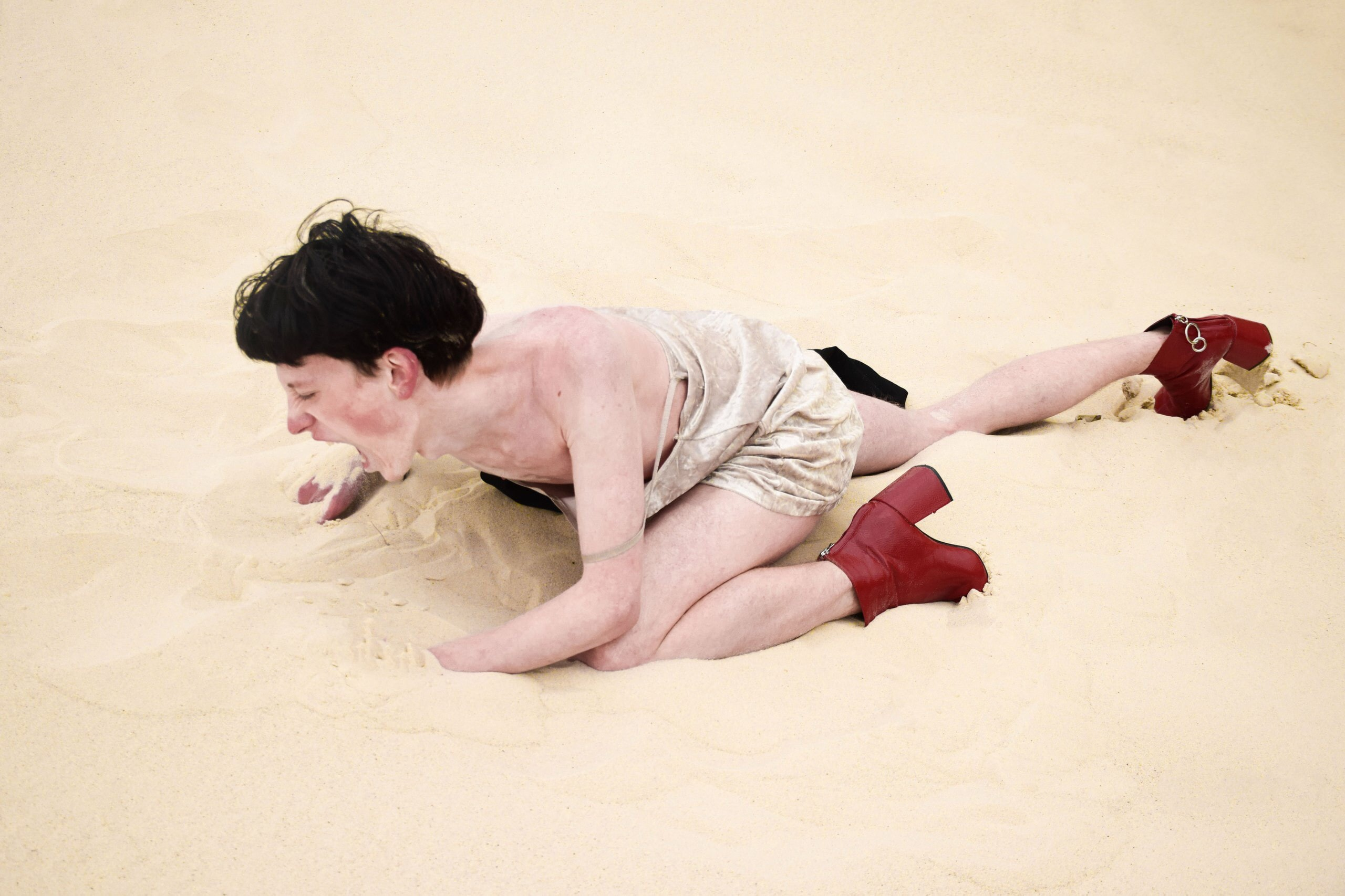 person crawling on sand