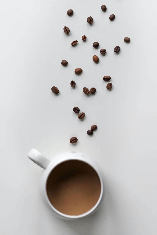 coffee beans and coffee filled mug
