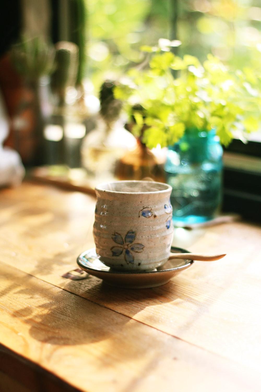 gray teacup on saucer